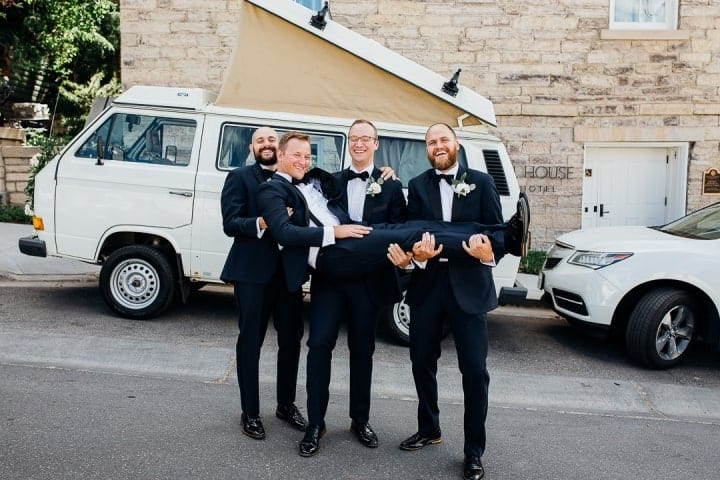 Bright-Clear-Groomsmen-Photo-Ideas-Holding-Groom