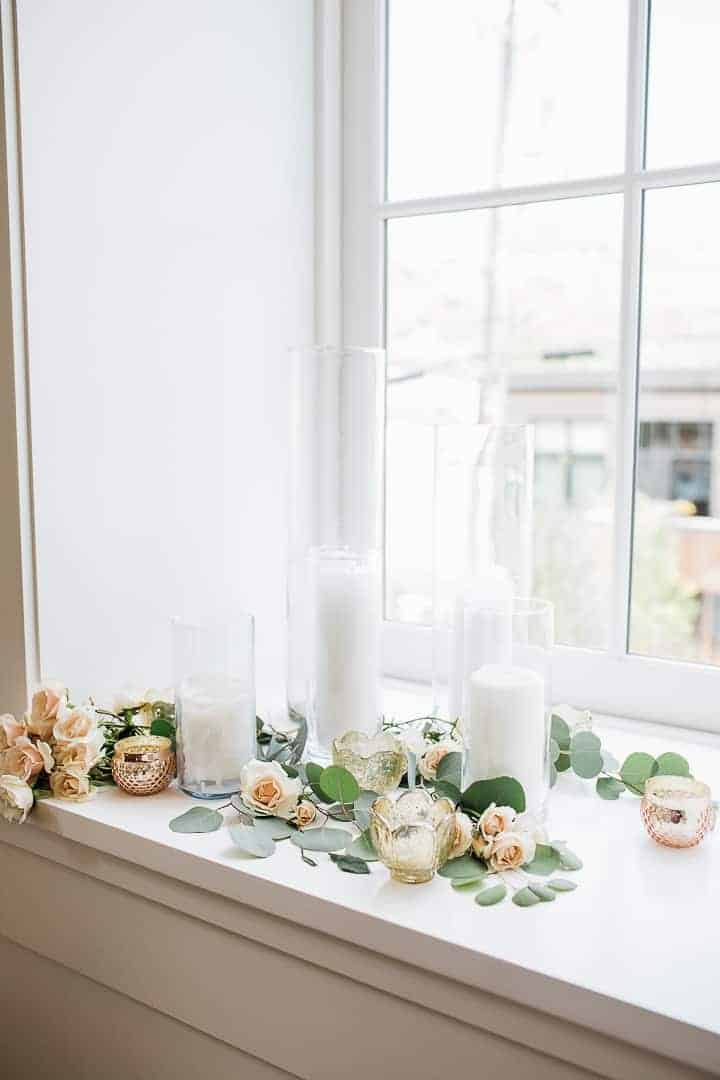Beautiful-White-Wedding-Candles-Greenery