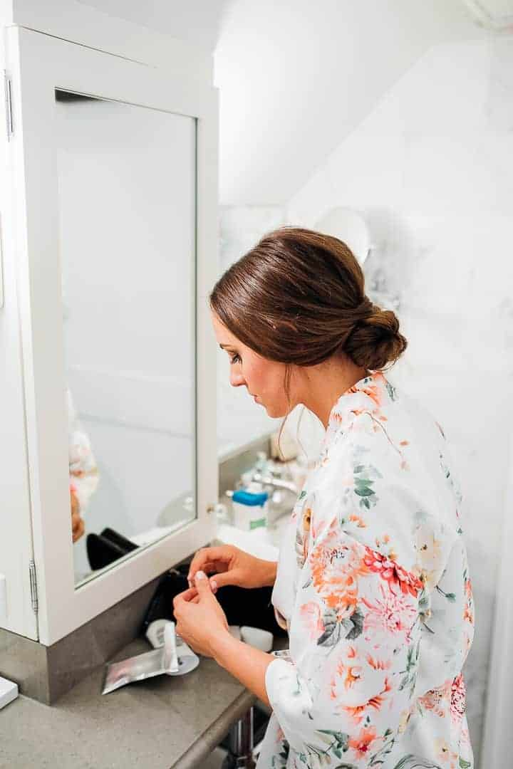 Sleek-Brown-Hair-Wedding-Bun-Floral-Robe