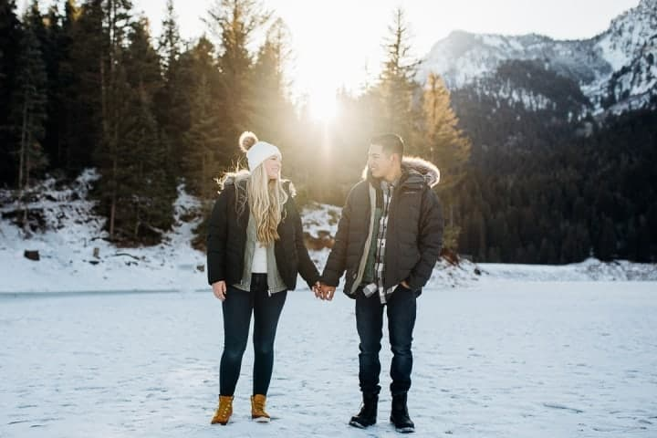Couple-Holding-Hands-Into-The-Sunset-Utah