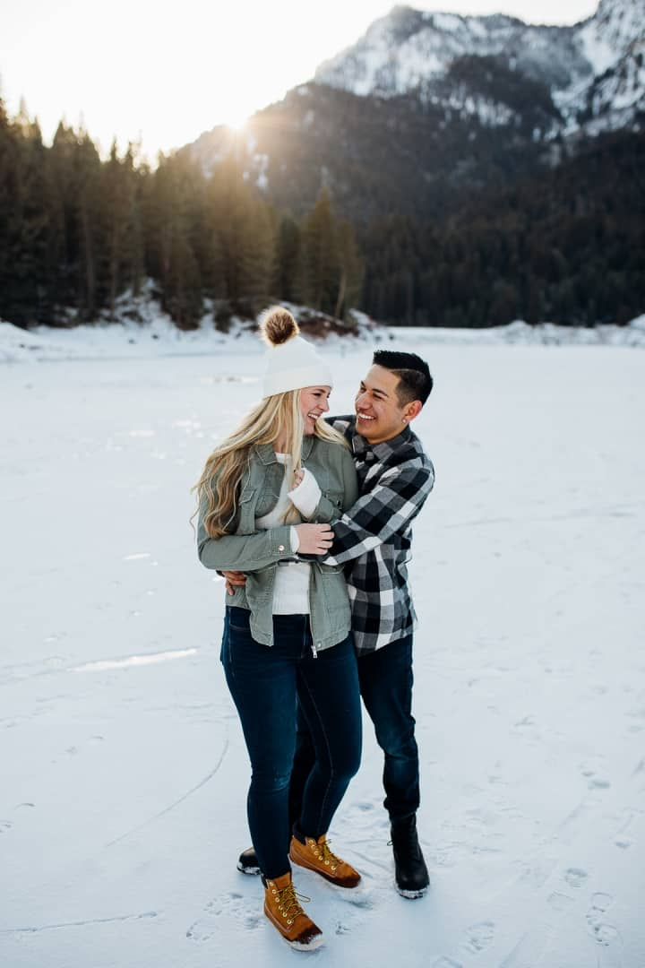 Romantic-Engagement-Couple-Hugging-In-The-Snow