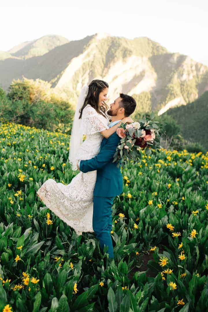 Groom-Lifts-Bride-Sunset-Utah-Mountains