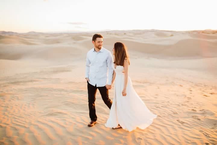 Engagement-Couple-Holding-Hands-In-The-Sand-Sahara-Desert-Utah