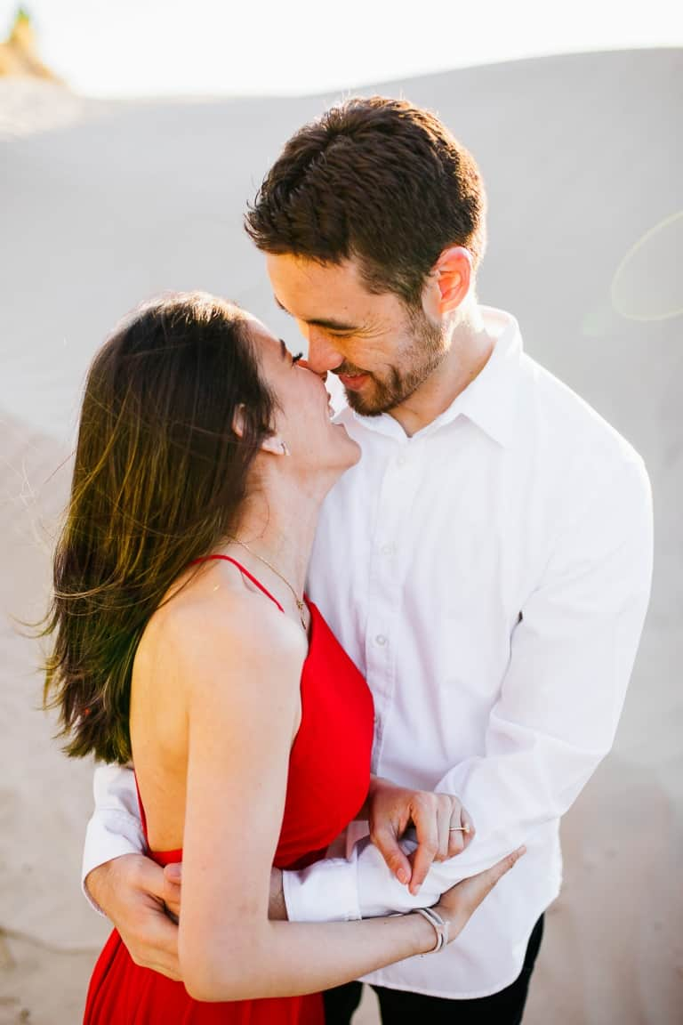 Engagement kisses in the sand