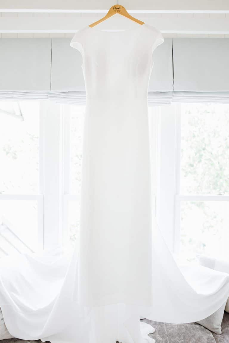 bright and white window light illuminating wedding dress