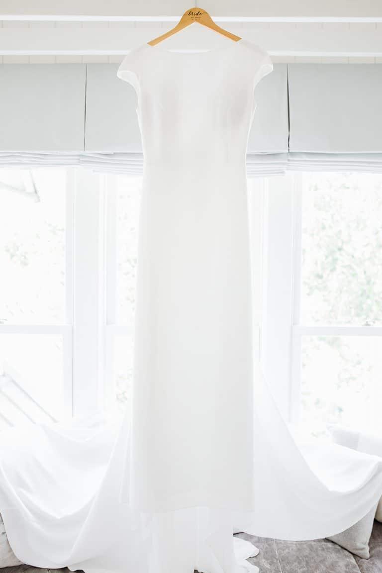 bright and white window light illuminating wedding dress