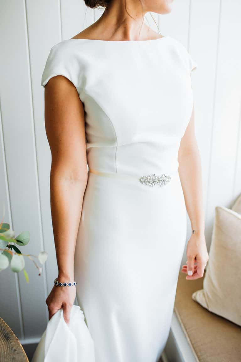 Details of brides bright white wedding dress