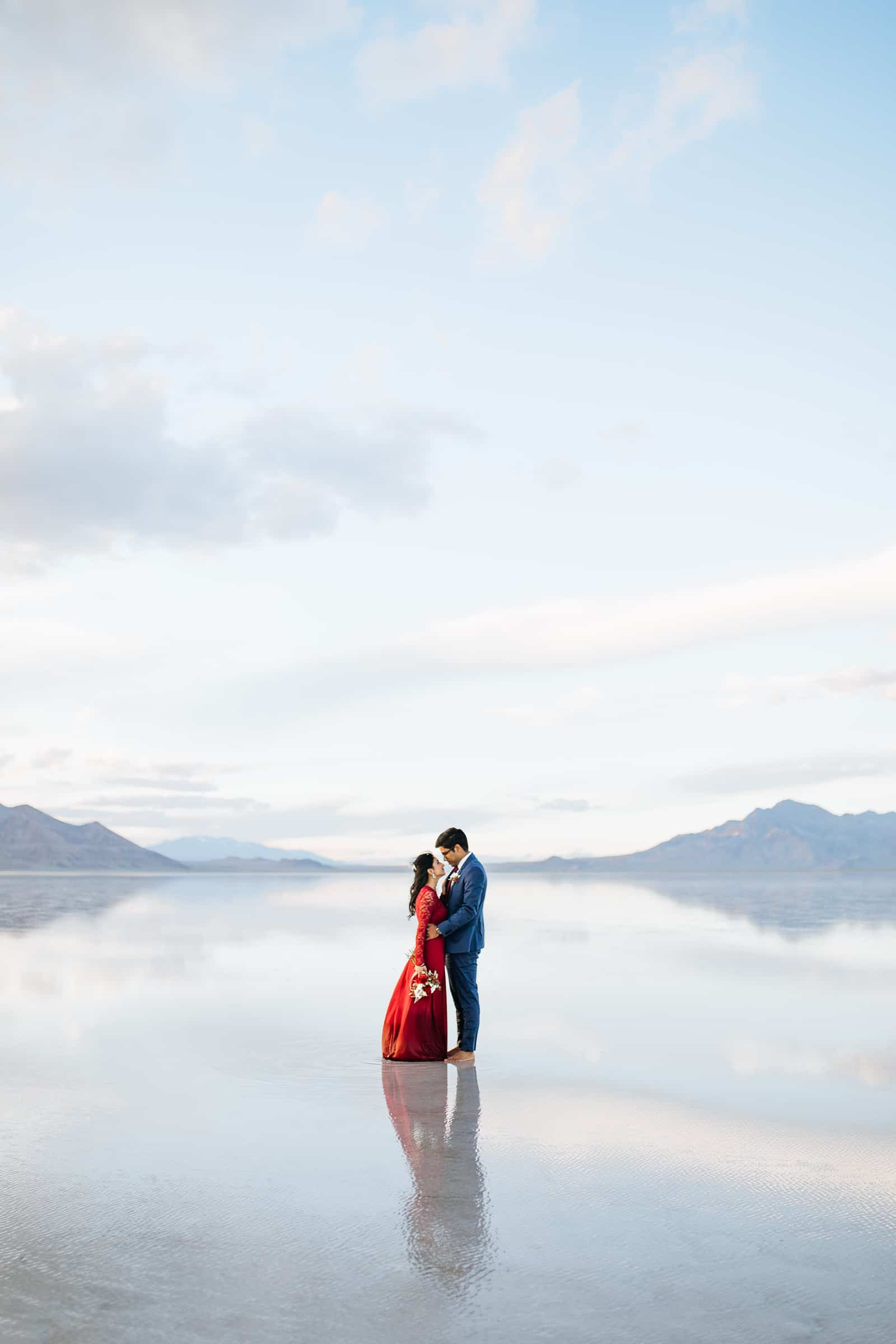 Bonneville Salt Flats Engagement Photos, Utah engagement session, engagement photography, red dress, clouds, water reflection, destination wedding