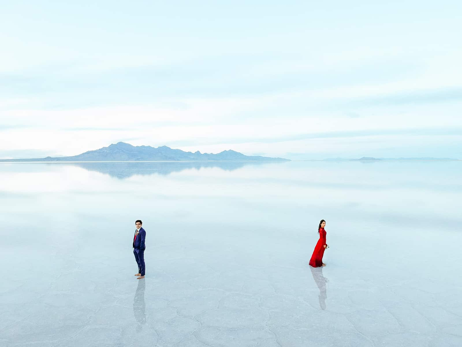 drone photography, Bonneville Salt Flats Engagement Photos, Utah engagement session, engagement photography, red dress, clouds, water reflection, destination wedding