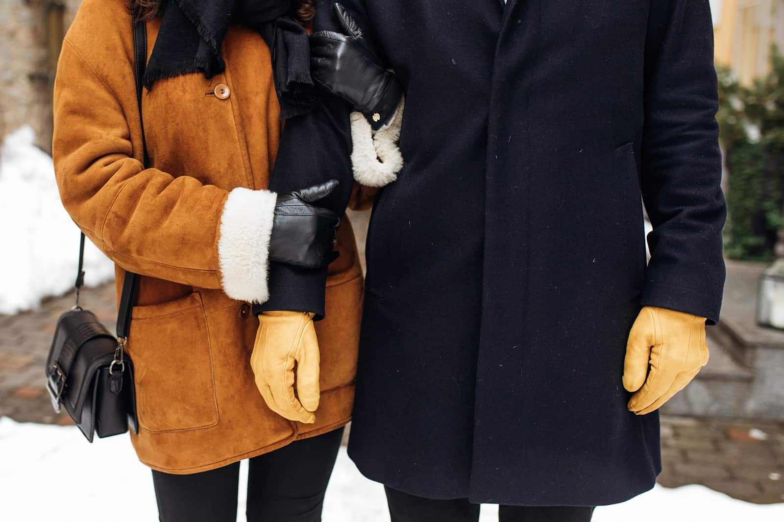 winter couple with coats, gloves and scarf