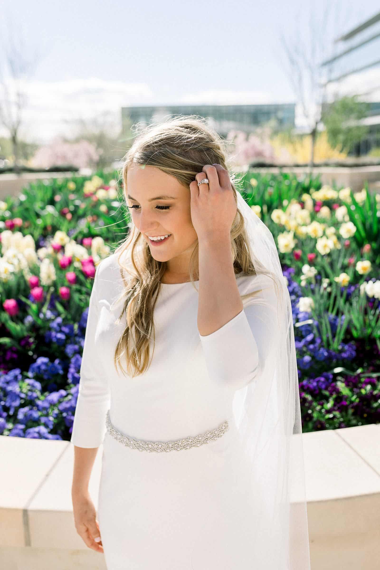 spring wedding tulips, modest wedding dress, spring bride, wedding ring, engagement ring, long wedding hairstyle, LDS bride, modern wedding dress