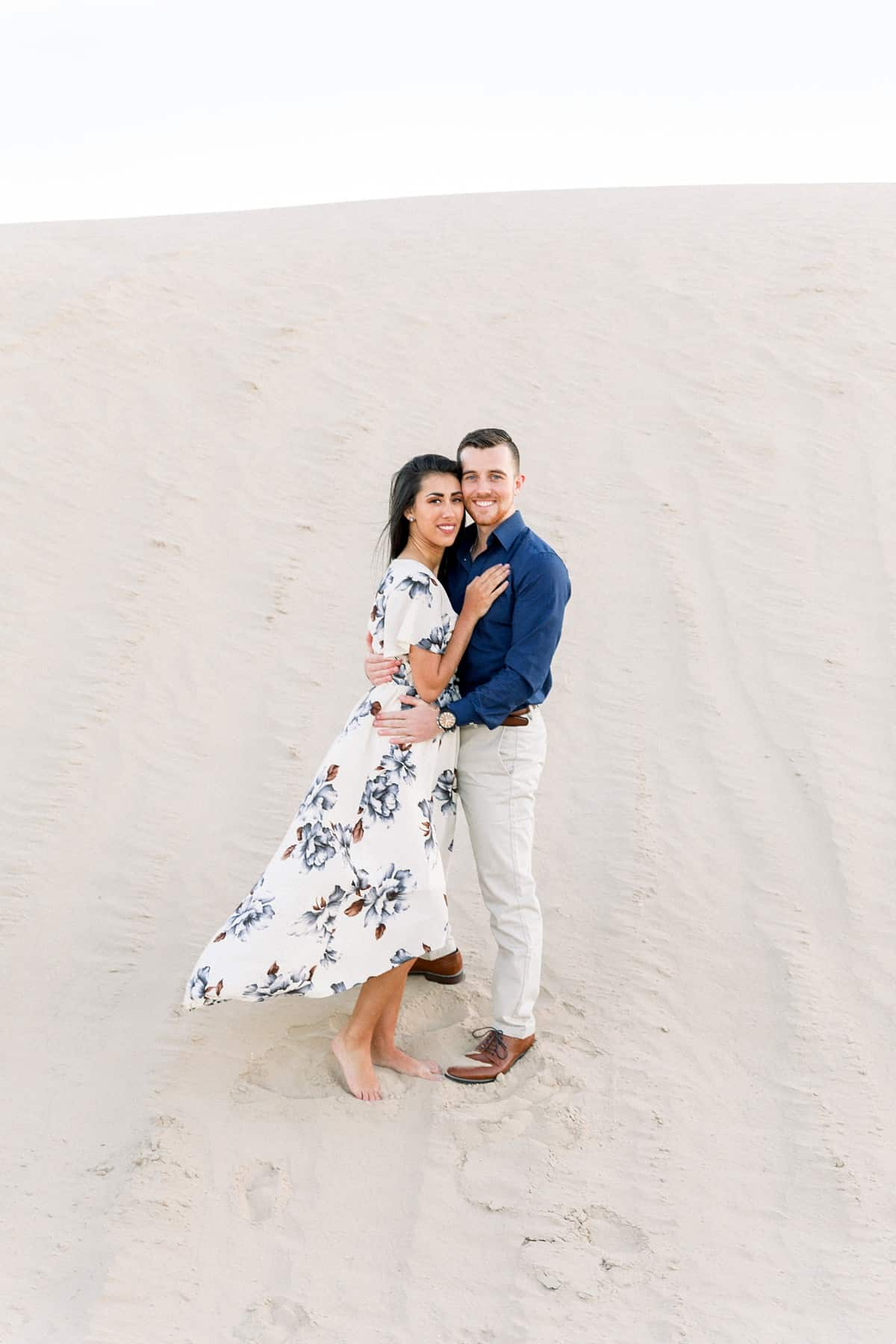What to wear for engagement pictures, flowy floral dress, navy blue and white outfits
