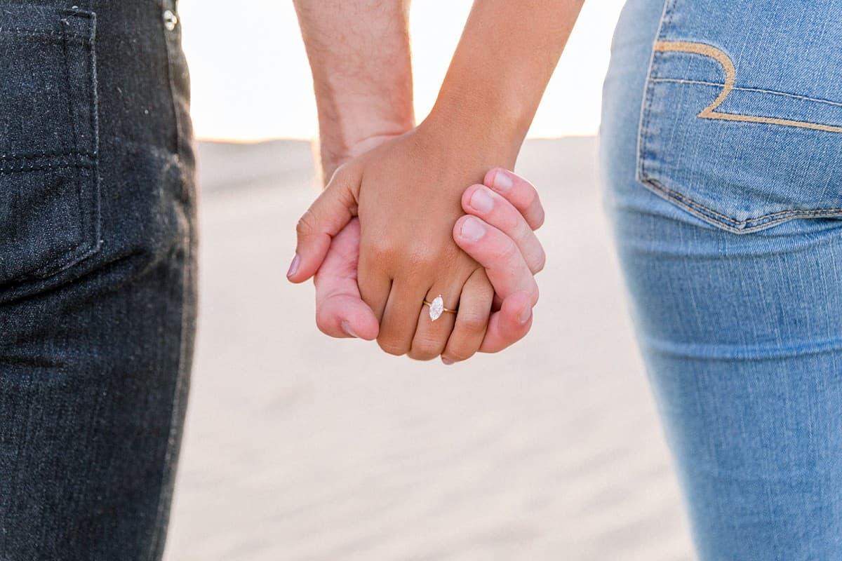 Utah engagement photographer, engagement ring, marquis diamond, desert engagement pictures