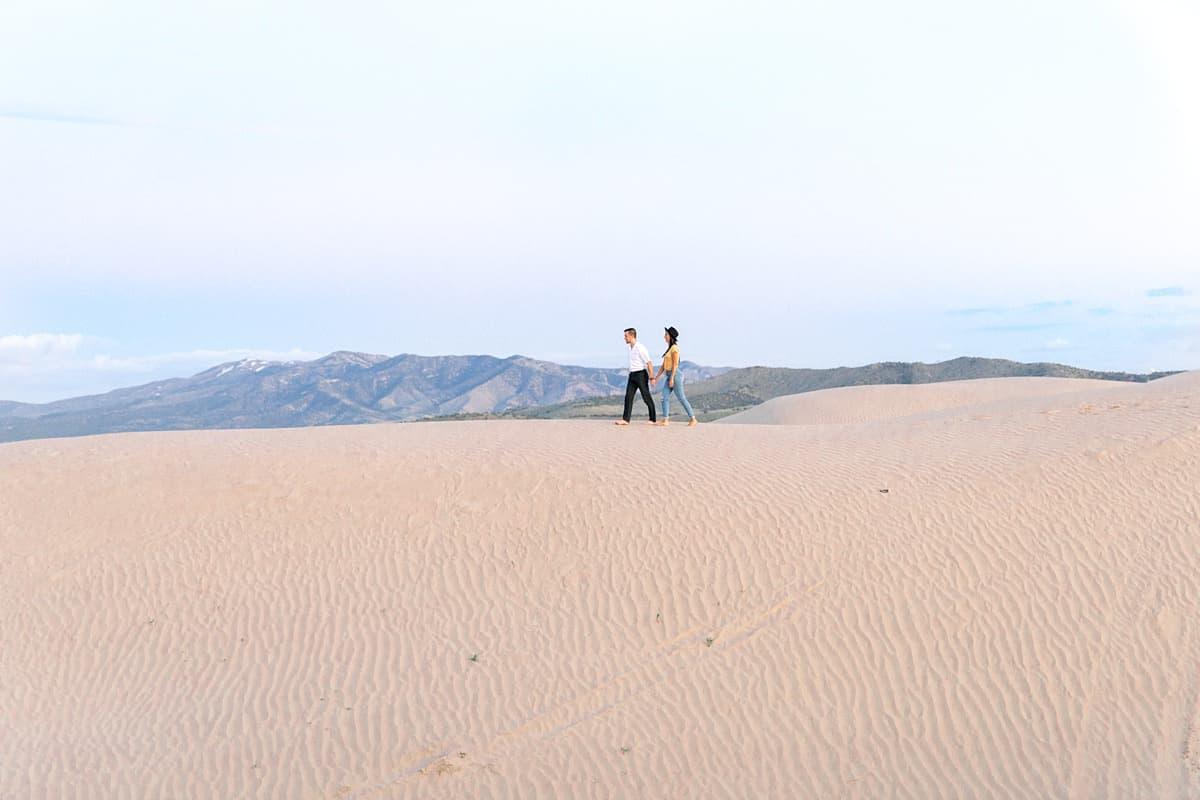 Little Sahara Sand Dunes Fun Engagement Photos at sunset, summer outfit, Utah desert photography