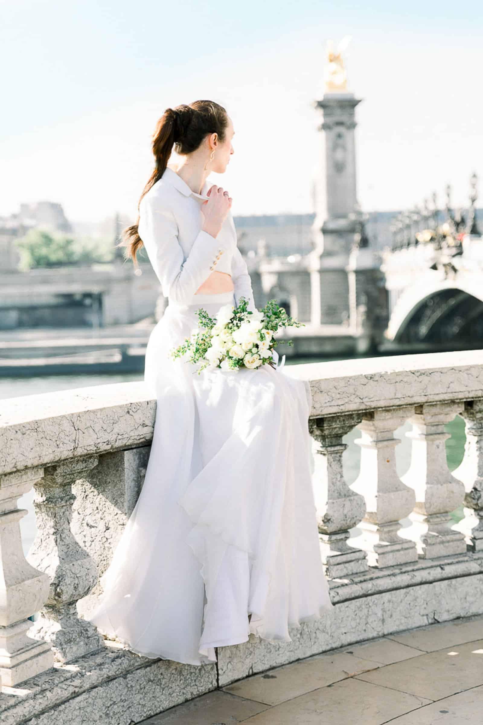 Modern high fashion bride in Paris, France at Pont Alexandre III bridge