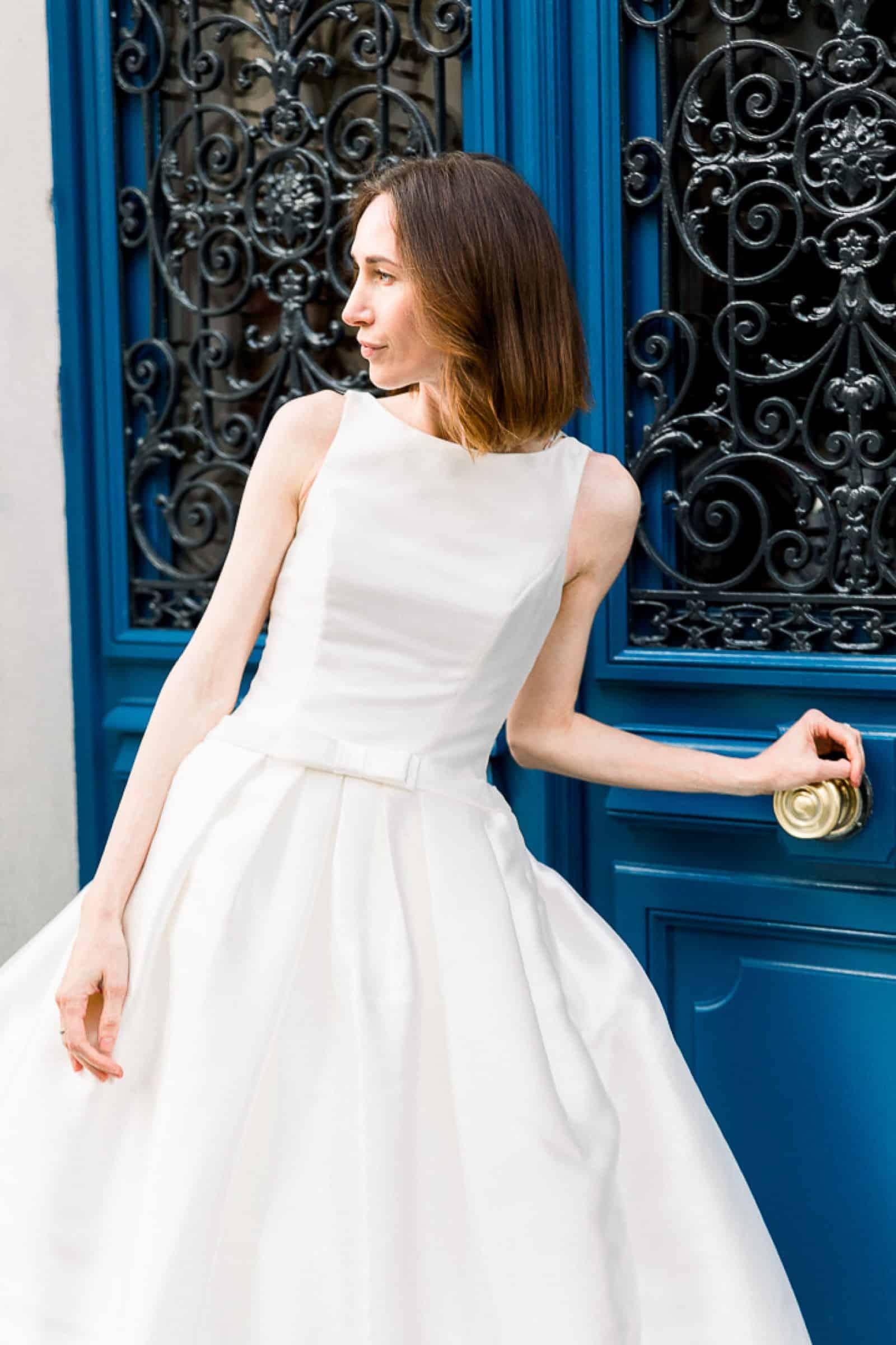 Modern bride in Paris, France with blue door