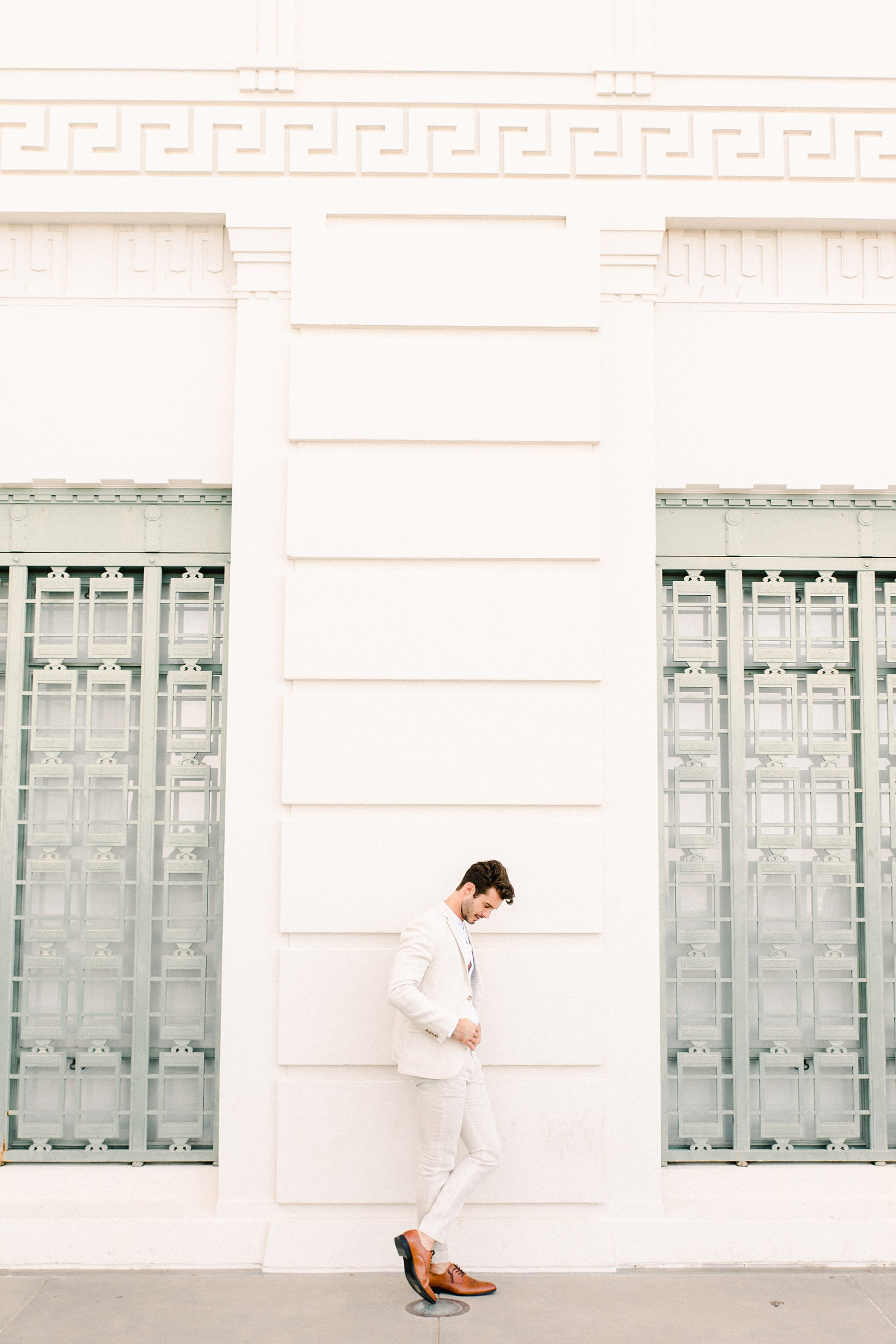 Modern timeless wedding photography at the Griffith Observatory in Los Angeles, California destination wedding photographer, groom in light tan suit, Alex Prange model