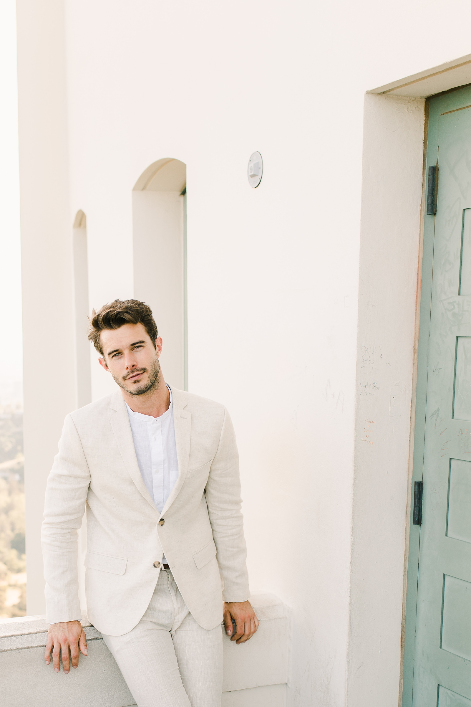 Modern timeless wedding photography at the Griffith Observatory in Los Angeles, California destination wedding photographer, groom in light tan suit, beach wedding inspiration