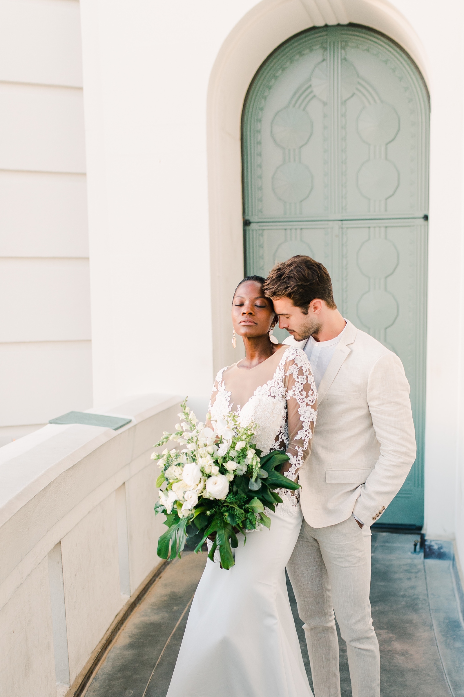 Modern timeless wedding photography at the Griffith Observatory in Los Angeles, California destination wedding photographer, bride and groom green door
