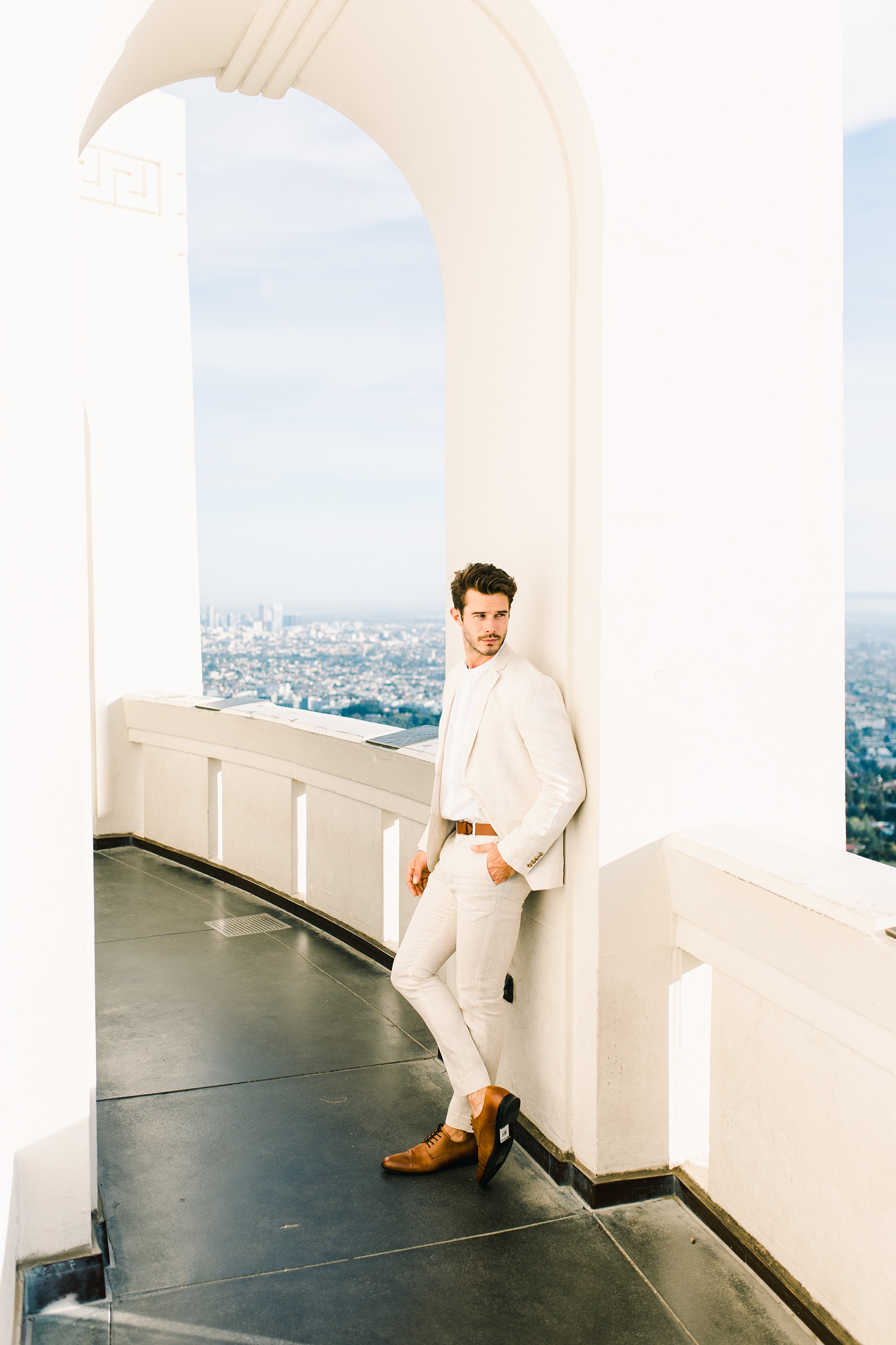 Modern timeless wedding photography at the Griffith Observatory in Los Angeles, California destination wedding photographer, groom in light tan suit for beach wedding