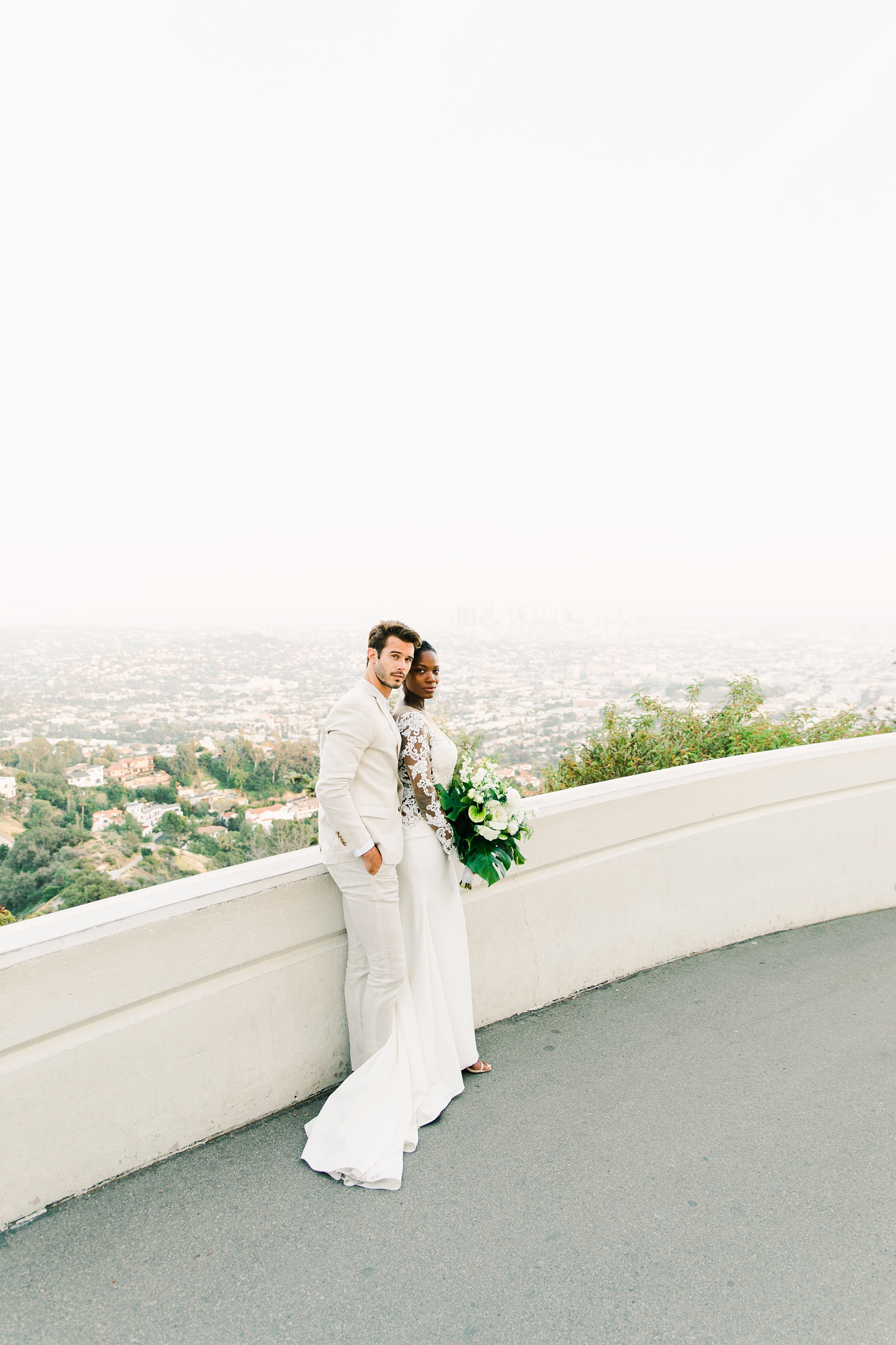 Modern timeless wedding photography at the Griffith Observatory in Los Angeles, California destination wedding photographer, bride and groom with view of city