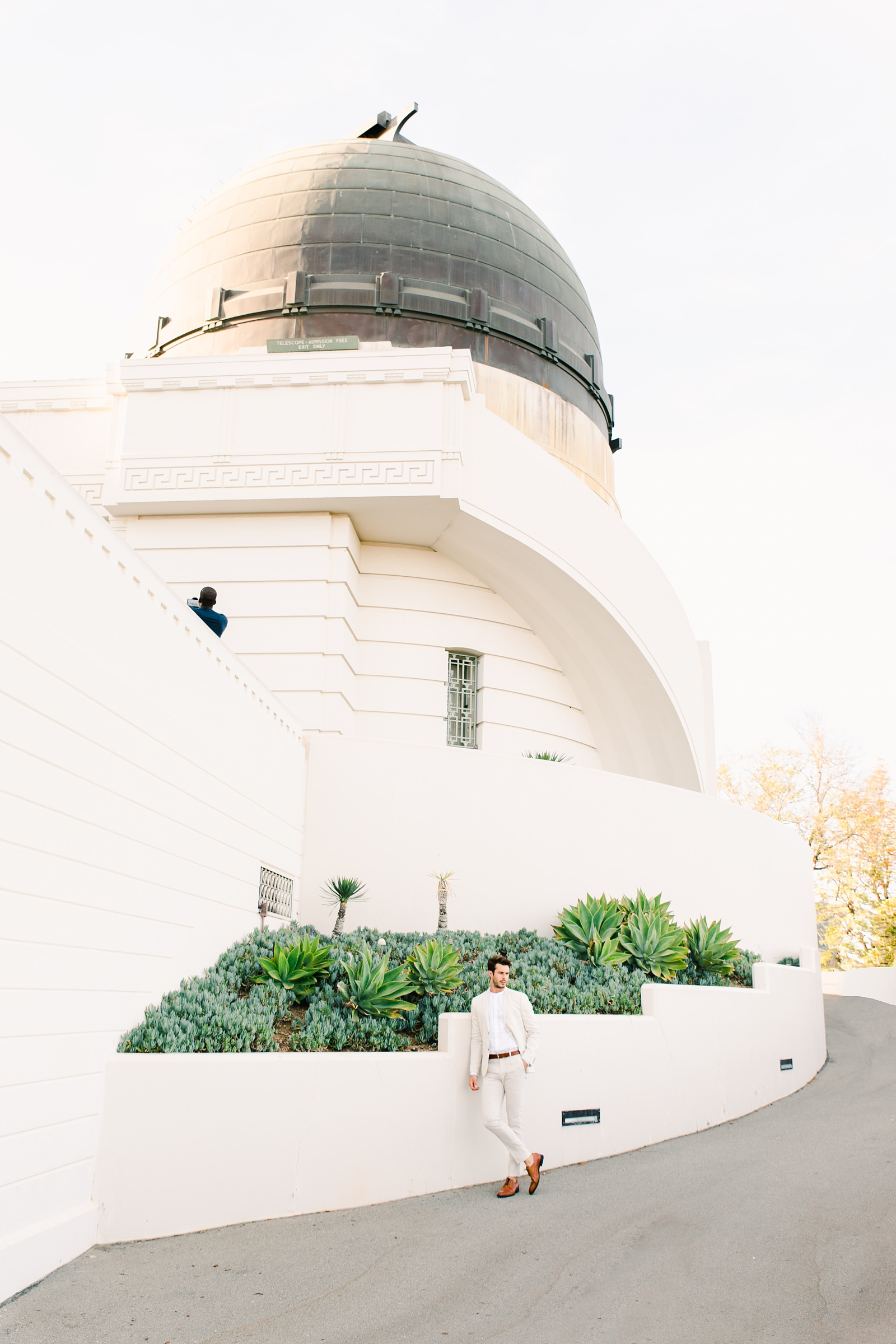 Modern timeless wedding photography at the Griffith Observatory in Los Angeles, California destination wedding photographer, groom in light tan suit