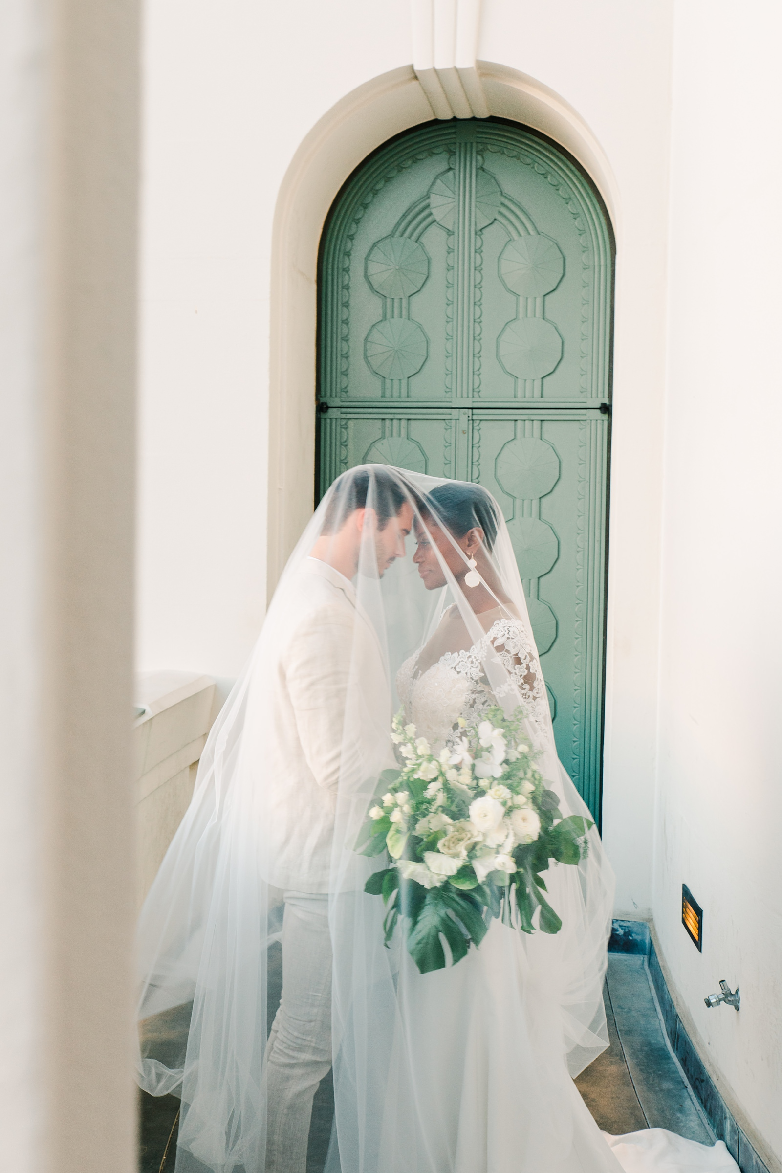 Modern timeless wedding photography at the Griffith Observatory in Los Angeles, California destination wedding photographer, bride and groom with long veil, film photography
