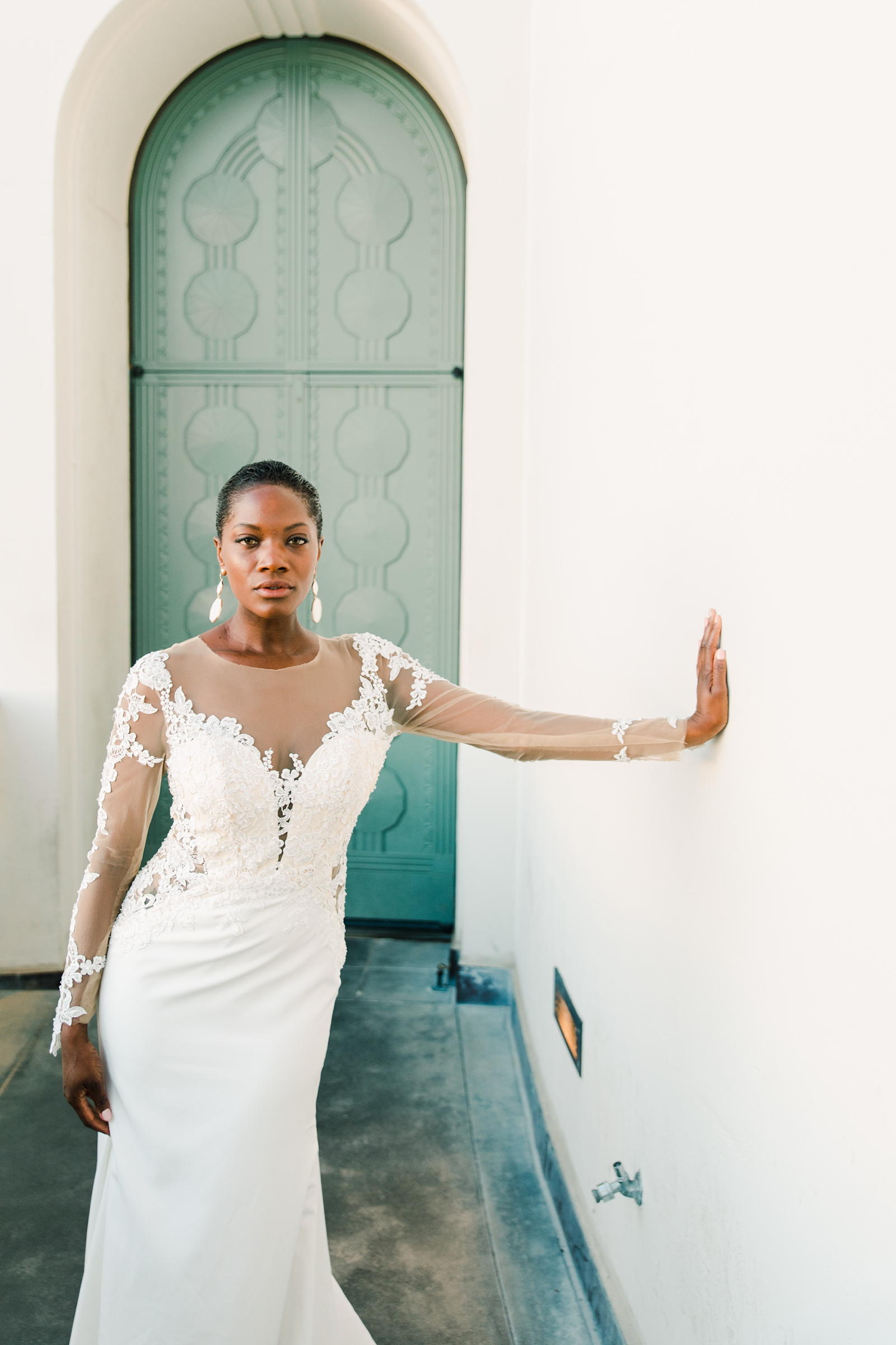 Modern timeless wedding photography at the Griffith Observatory in Los Angeles, California destination wedding photographer, modern bride with long sleeve lace dress, short hair