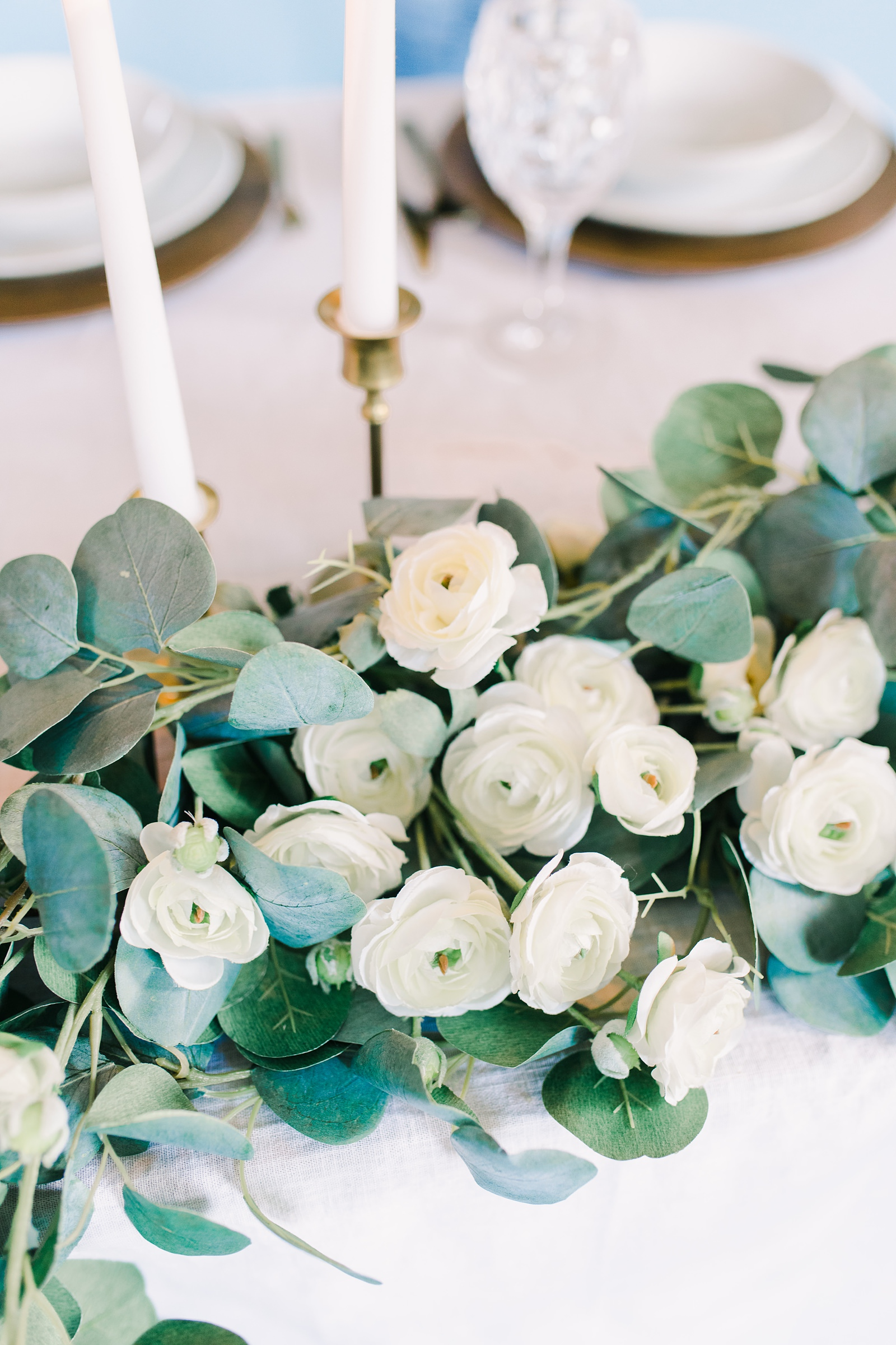 Utah wedding photography, sweetheart table with greenery garland centerpiece with eucalyptus and white ranunculus flowers and candlesticks and taper candles