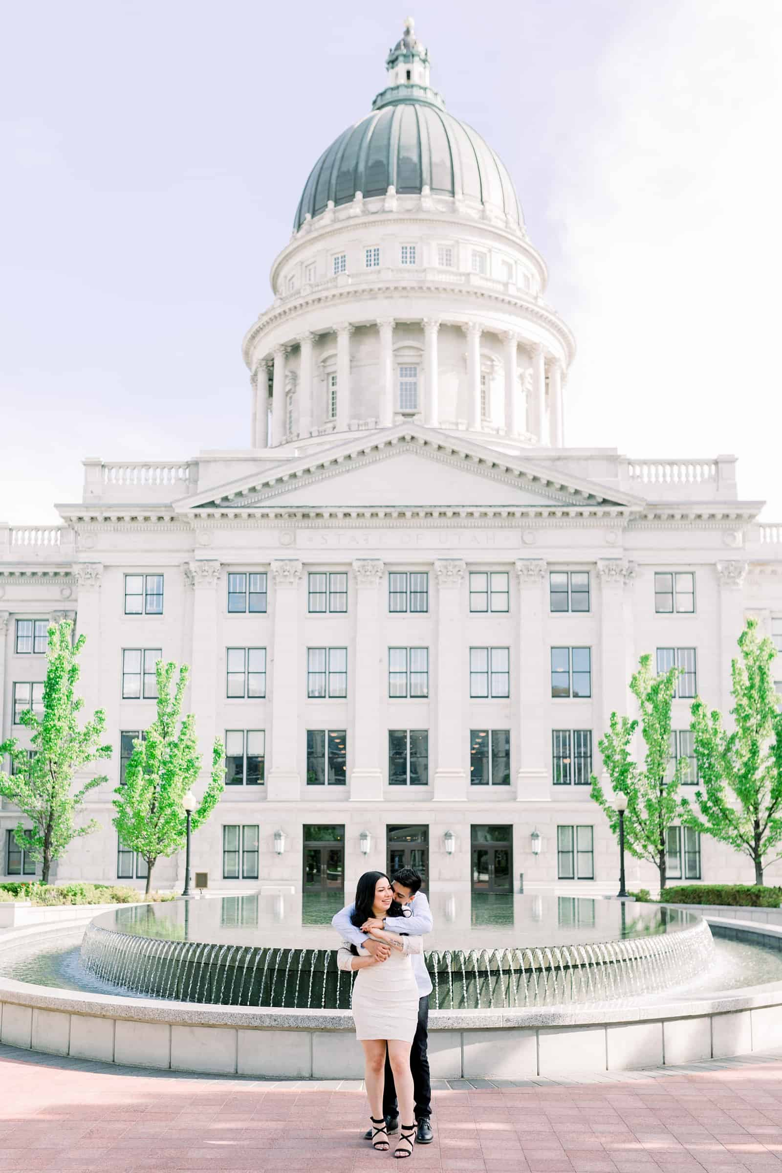 Classy engagement photos at the Utah State Capitol Building in downtown Salt Lake City, spring fountain pictures