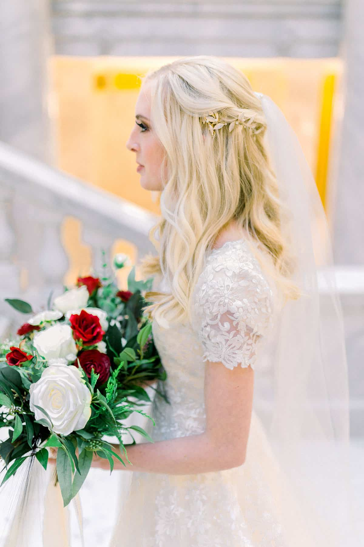 Modest lace wedding dress, bride long hairstyle, red and white wedding flowers bouquet