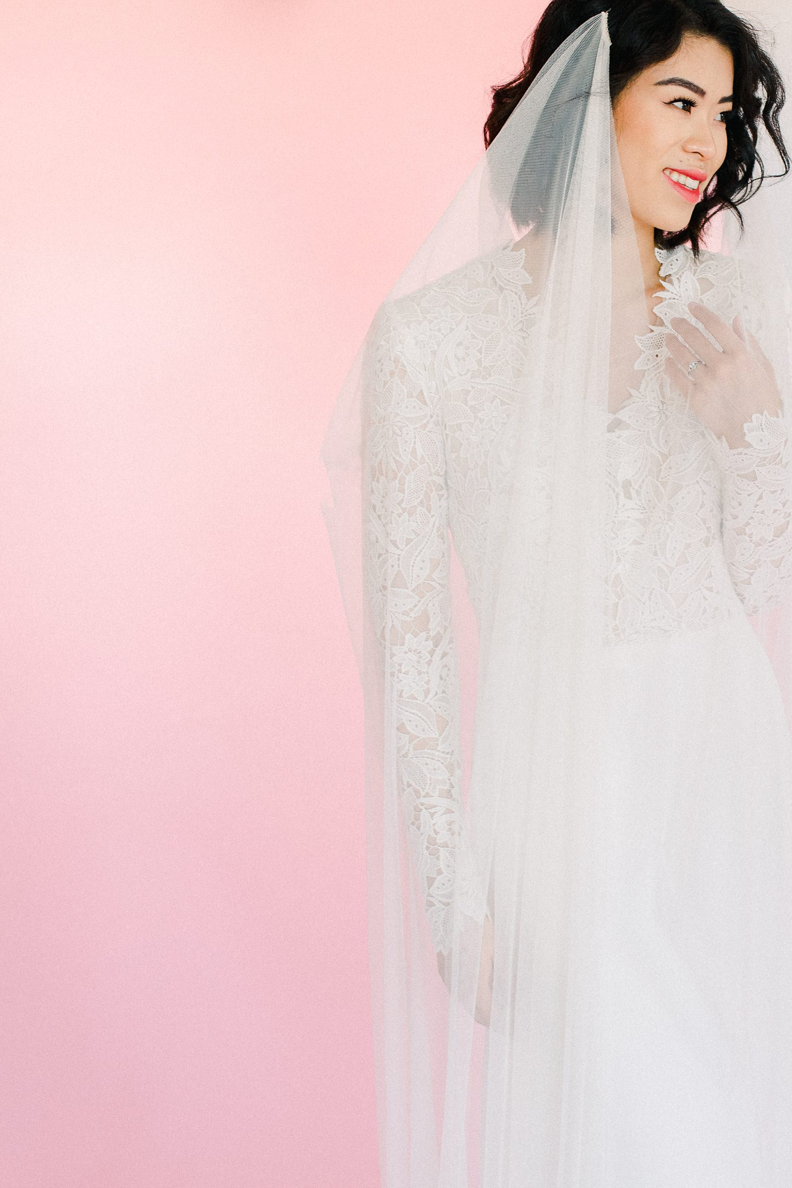 Utah wedding photography inspiration, bride in Lazaro lace v-neck wedding dress with vintage lace and long sleeves, draped long flowy veil