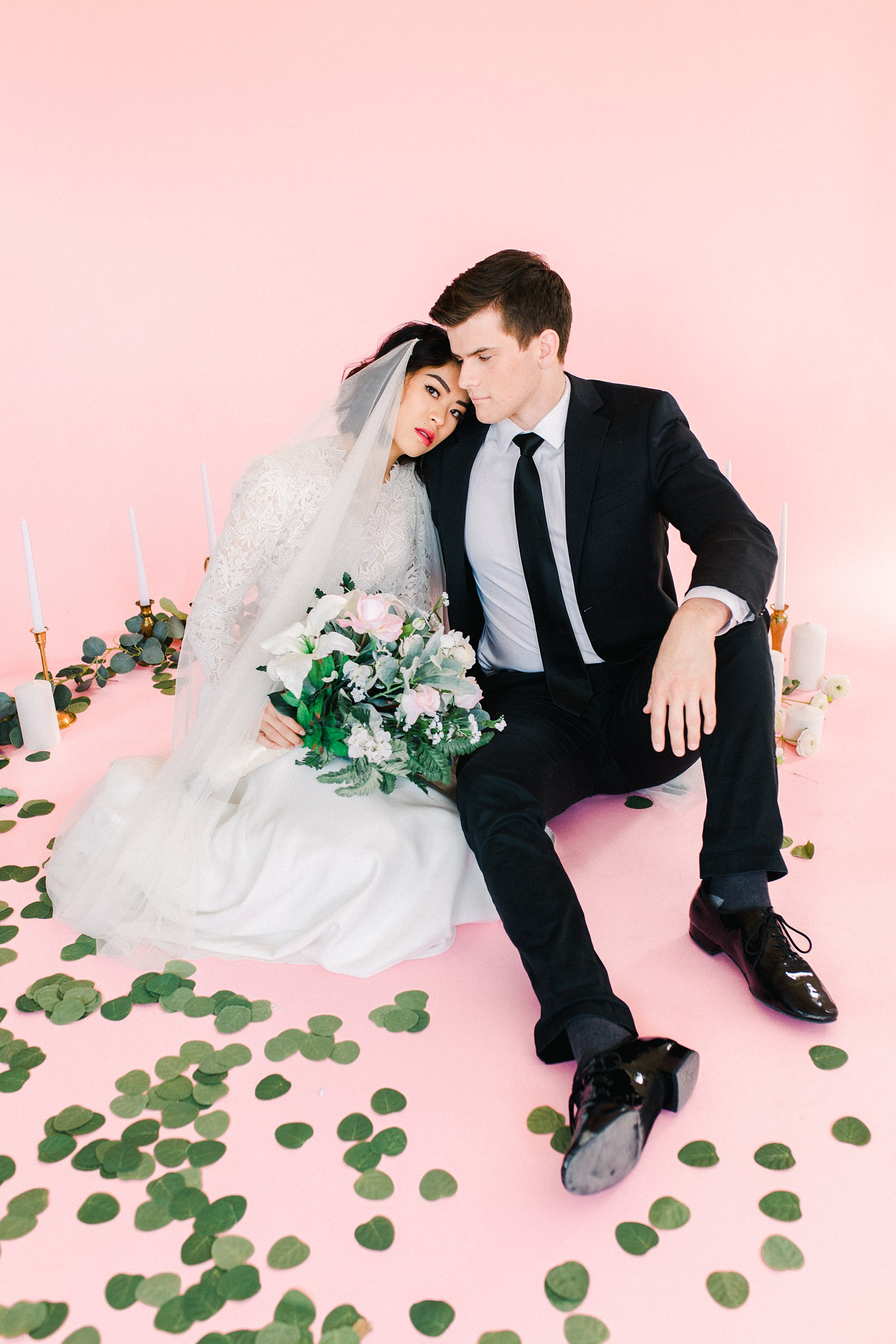 Utah wedding photography inspiration, bride in Lazaro lace v-neck wedding dress with vintage lace and long sleeves, draped long flowy veil, groom in black suit and tie