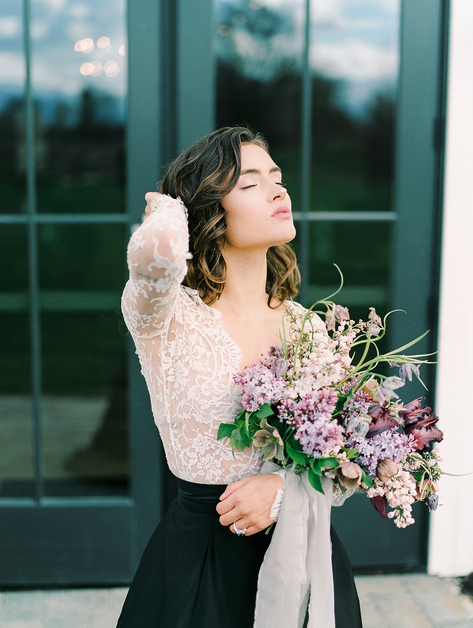 Heber Valley Natural Organic Wedding Inspiration at River Bottoms Ranch, Utah wedding venue film photography, bride with lace long sleeve top with black taffeta maxi skirt bridal separates, lilac purple wedding flowers bouquet