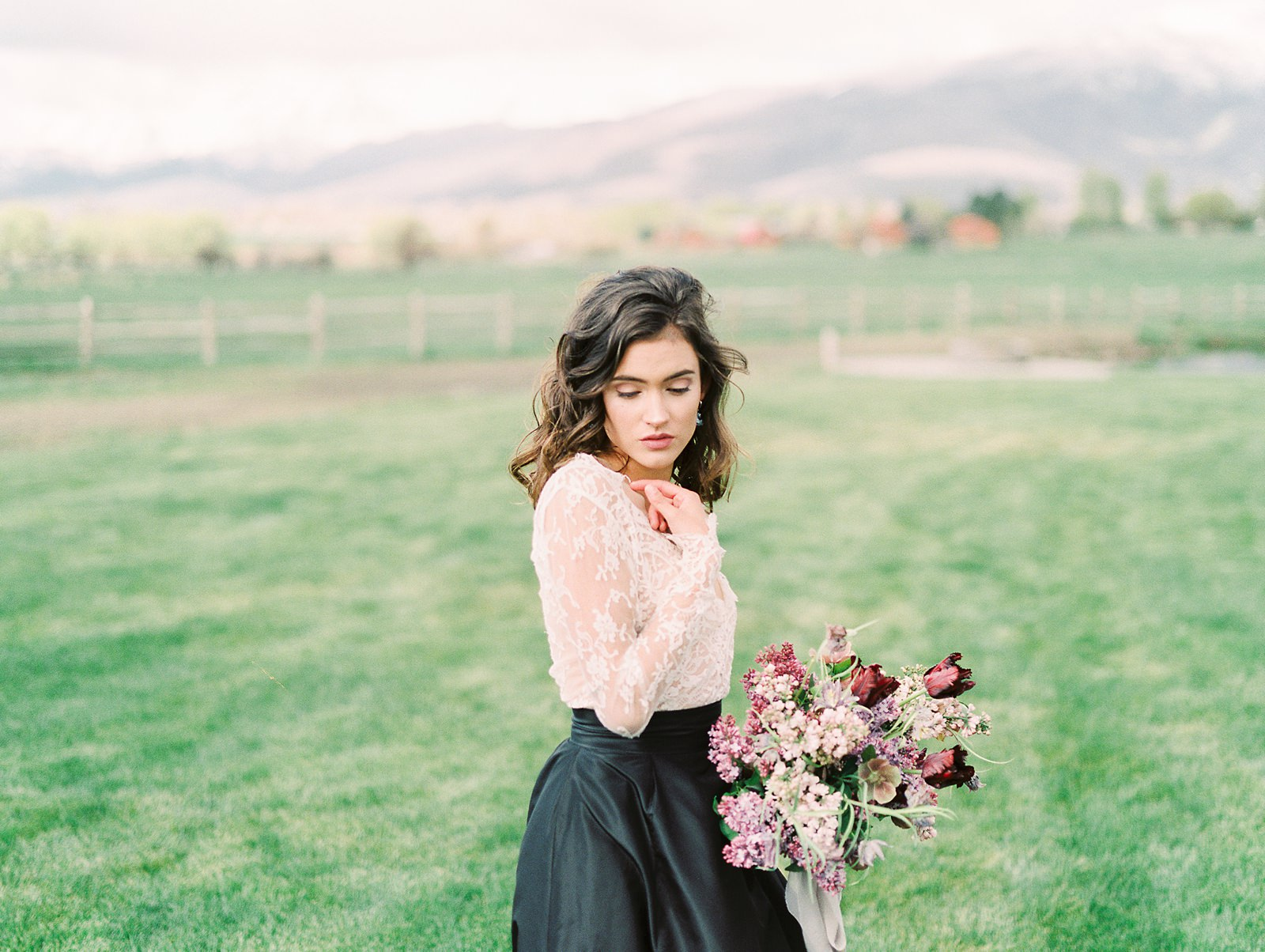 Heber Valley Natural Organic Wedding Inspiration at River Bottoms Ranch, Utah wedding venue film photography, bride with lace long sleeve top with black taffeta maxi skirt bridal separates, lilac purple wedding flowers bouquet, green field location