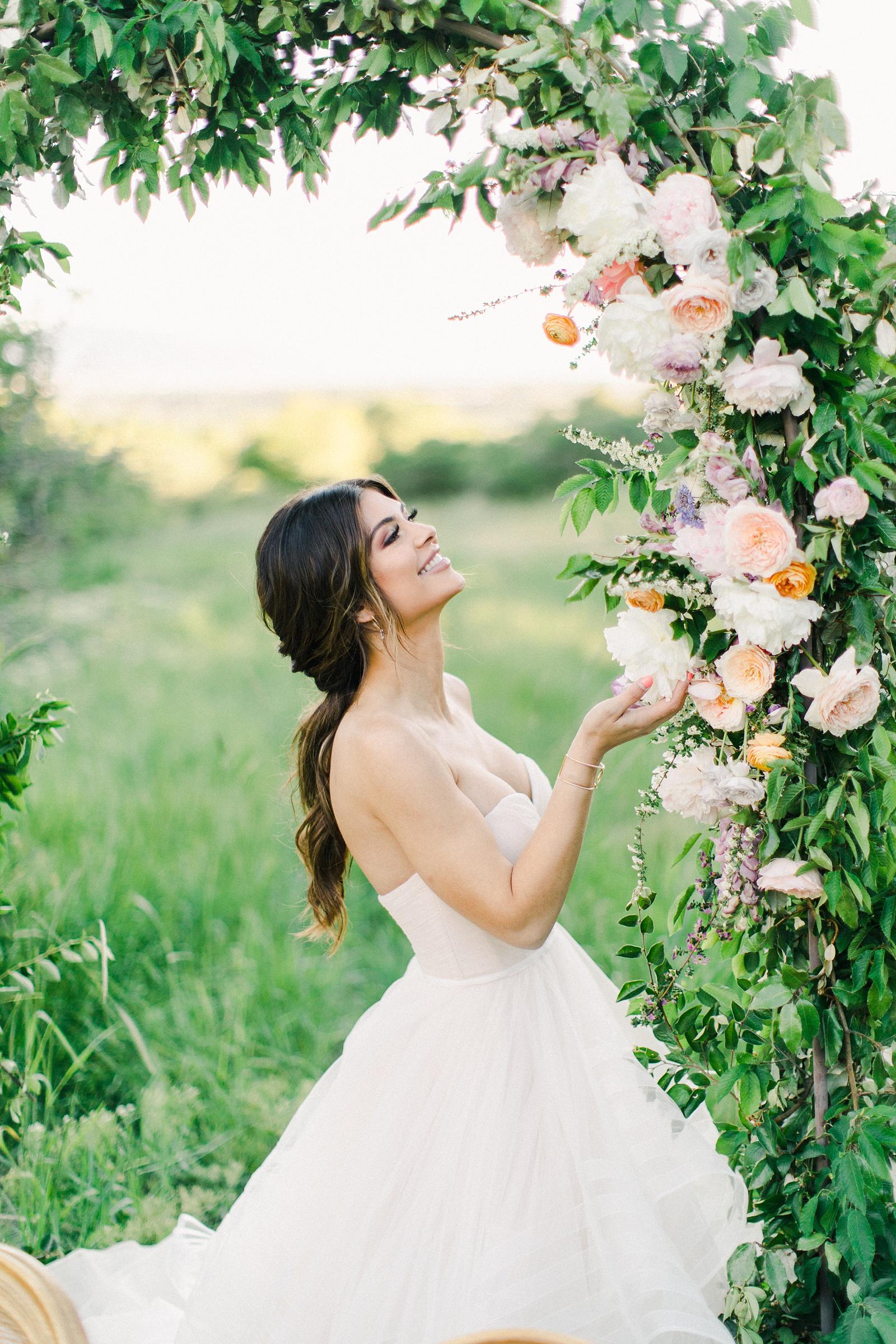Outdoor Spring Secret Garden Wedding, Provo Utah Film Wedding Photography, floral arch wedding flowers, bride wearing BHLDN wedding dress with sweetheart neckline