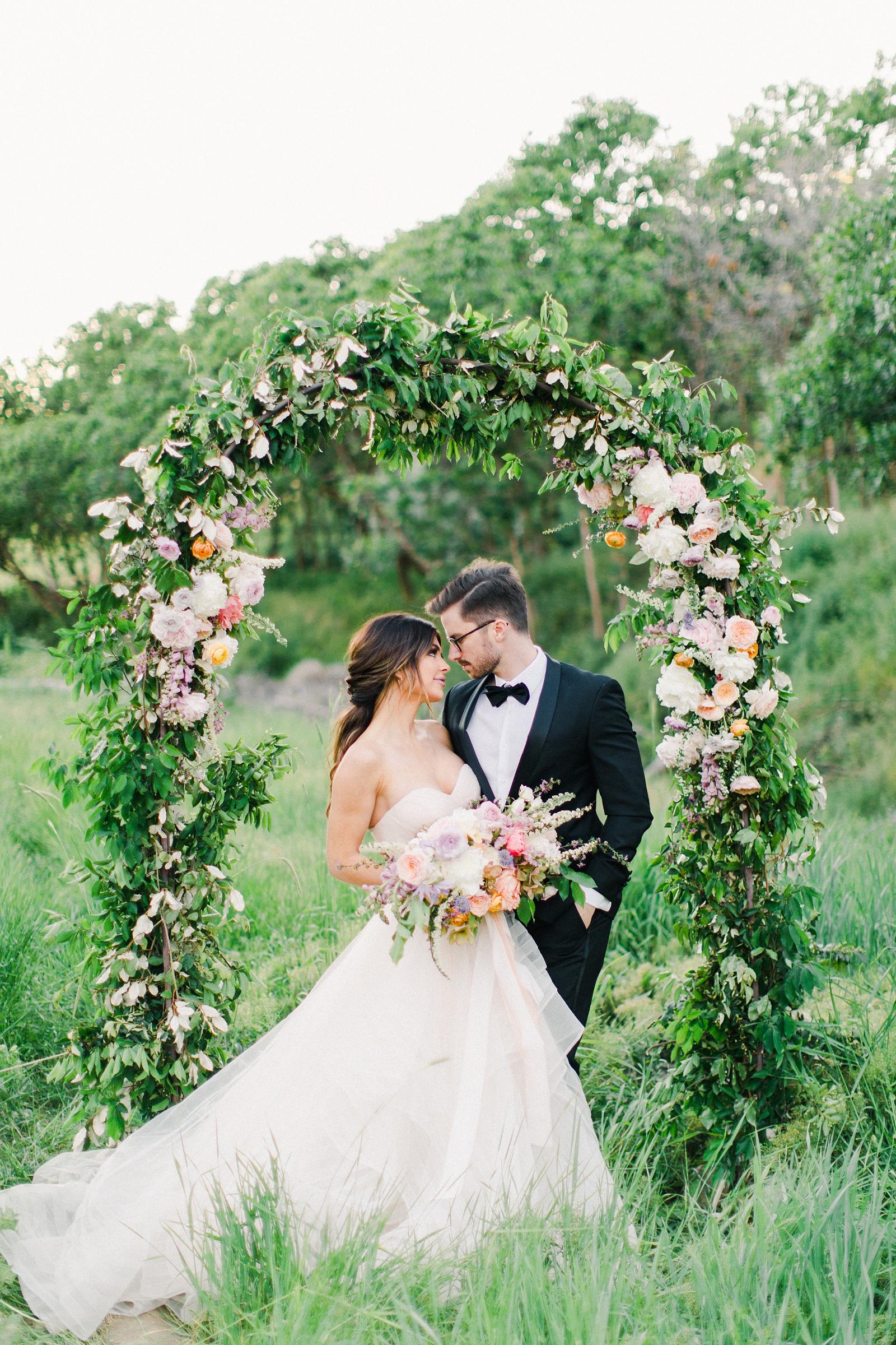 Outdoor Spring Secret Garden Wedding, Provo Utah Film Wedding Photography, bride and groom with floral arch wedding flowers