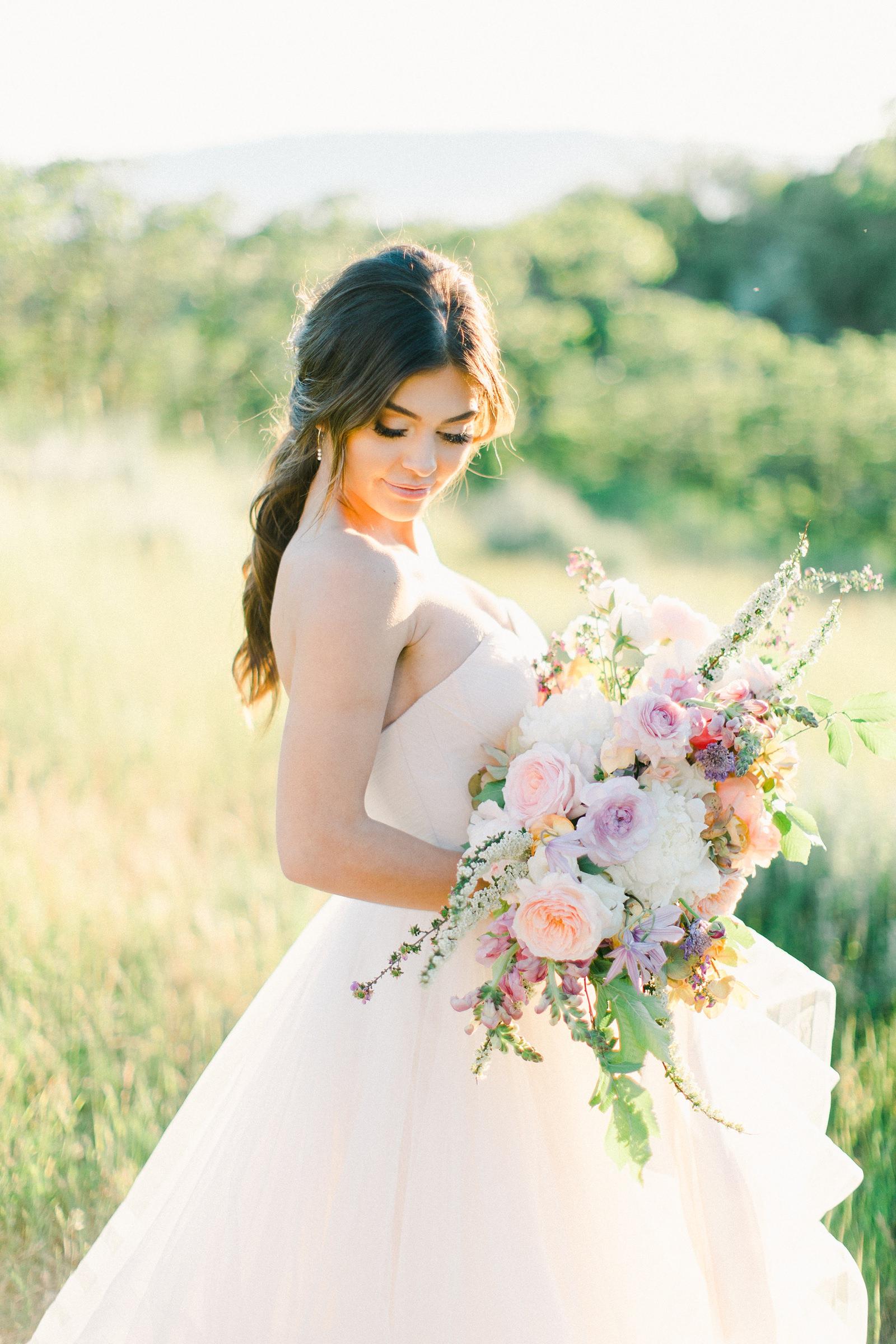 Outdoor Spring Secret Garden Wedding, Provo Utah Film Wedding Photography, pastel wildflower bouquet purple wedding flowers, bride wearing BHLDN wedding dress with sweetheart neckline