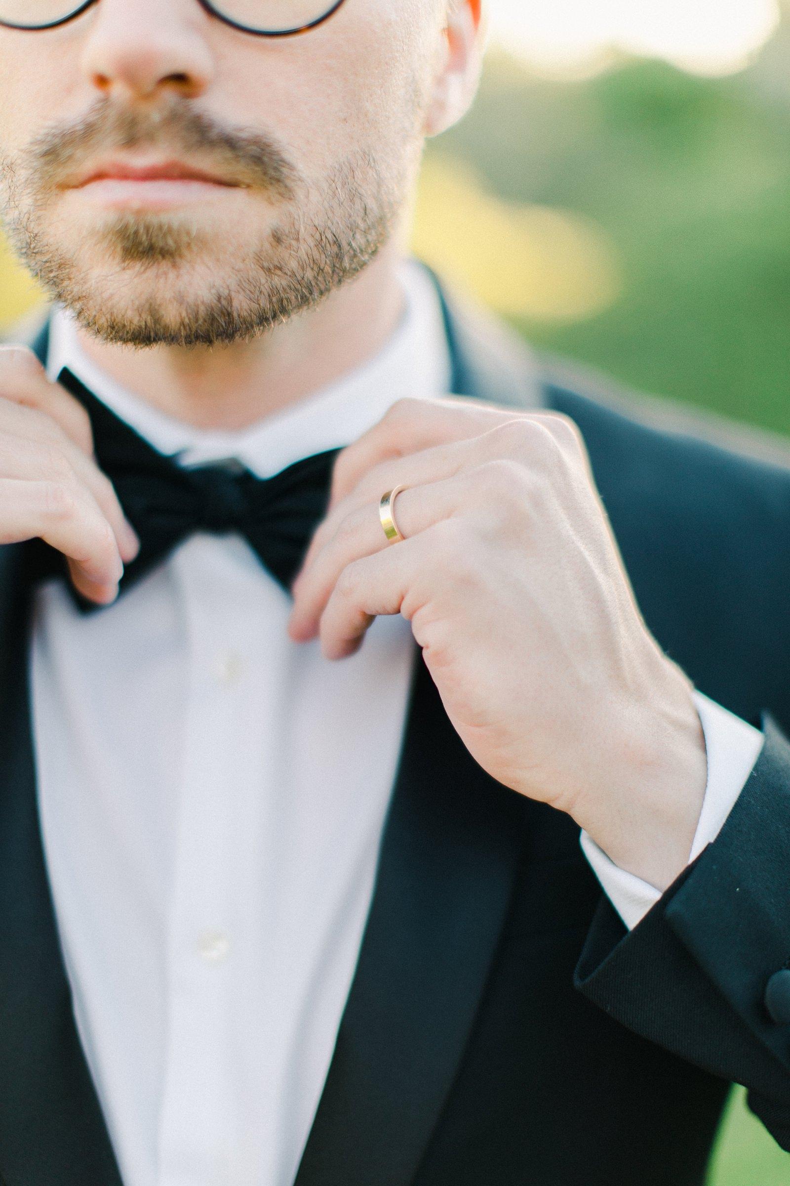 Outdoor Spring Secret Garden Wedding, Provo Utah Film Wedding Photography, groom wearing classic black tuxedo with bow tie golden hour sunset light