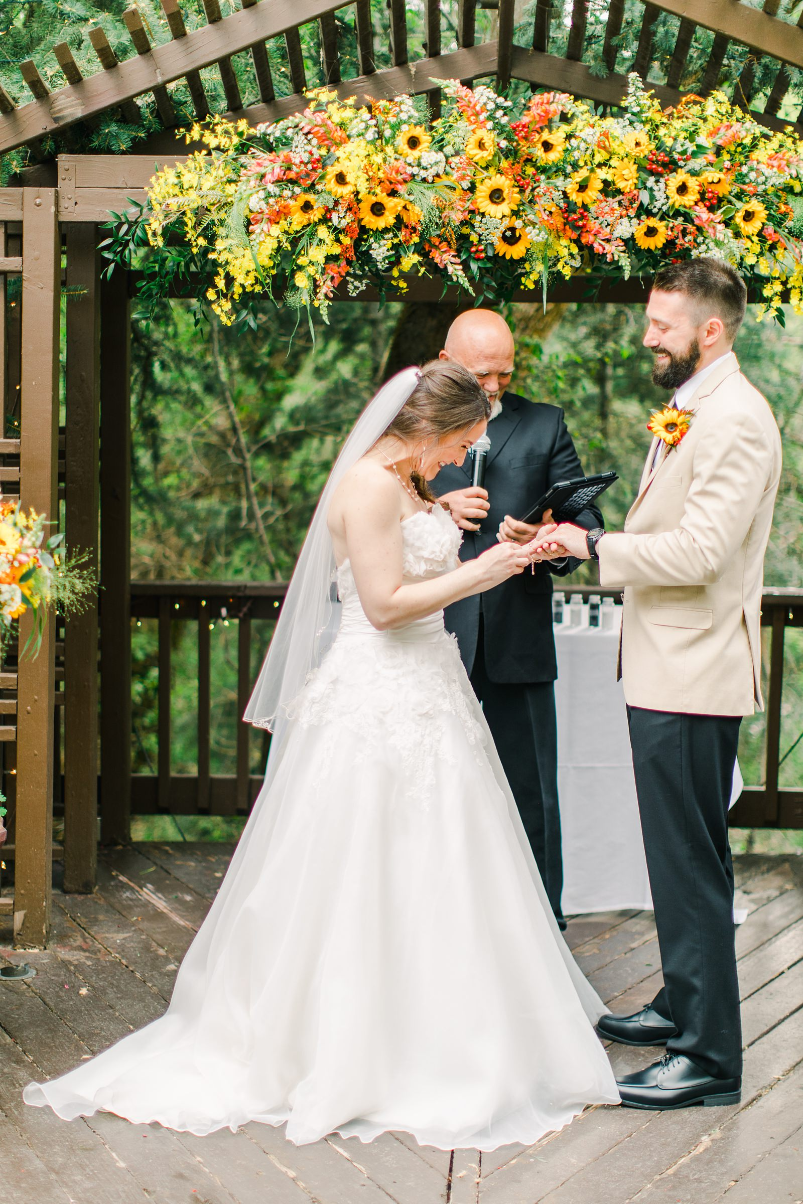 Millcreek Inn Summer Wedding, Utah wedding photography Millcreek Canyon, Salt Lake City, mountain ceremony, bride and groom under sunflower wildflower arch