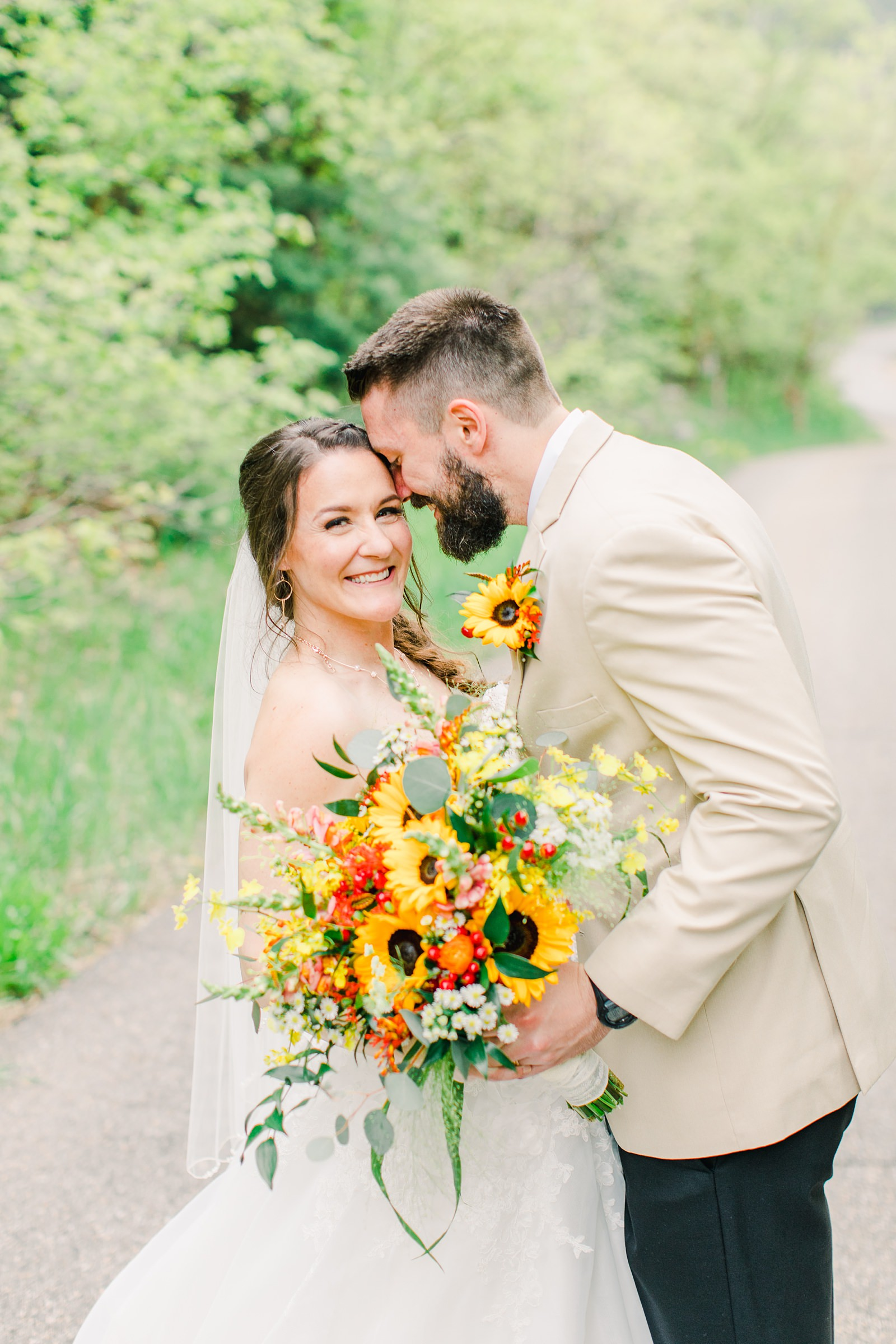 Millcreek Inn Summer Wedding, Utah wedding photography Millcreek Canyon, Salt Lake City, bride and groom sunflower yellow and orange bouquet wedding flowers