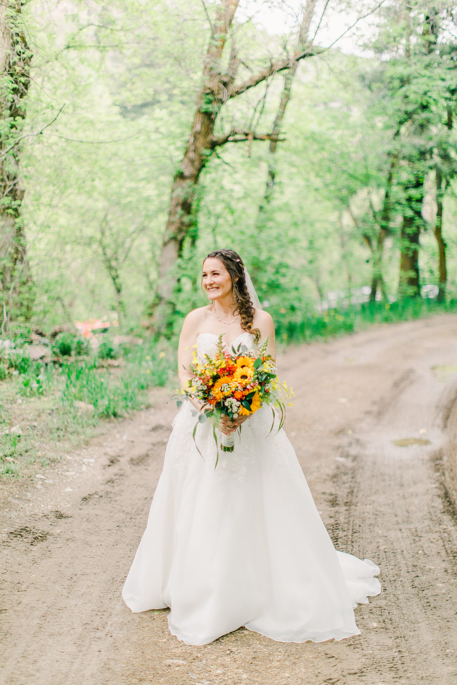 Millcreek Inn Summer Wedding, Utah wedding photography Millcreek Canyon, Salt Lake City, bride tulle ballgown with floral embellishments, sunflower yellow and orange bouquet wedding flowers