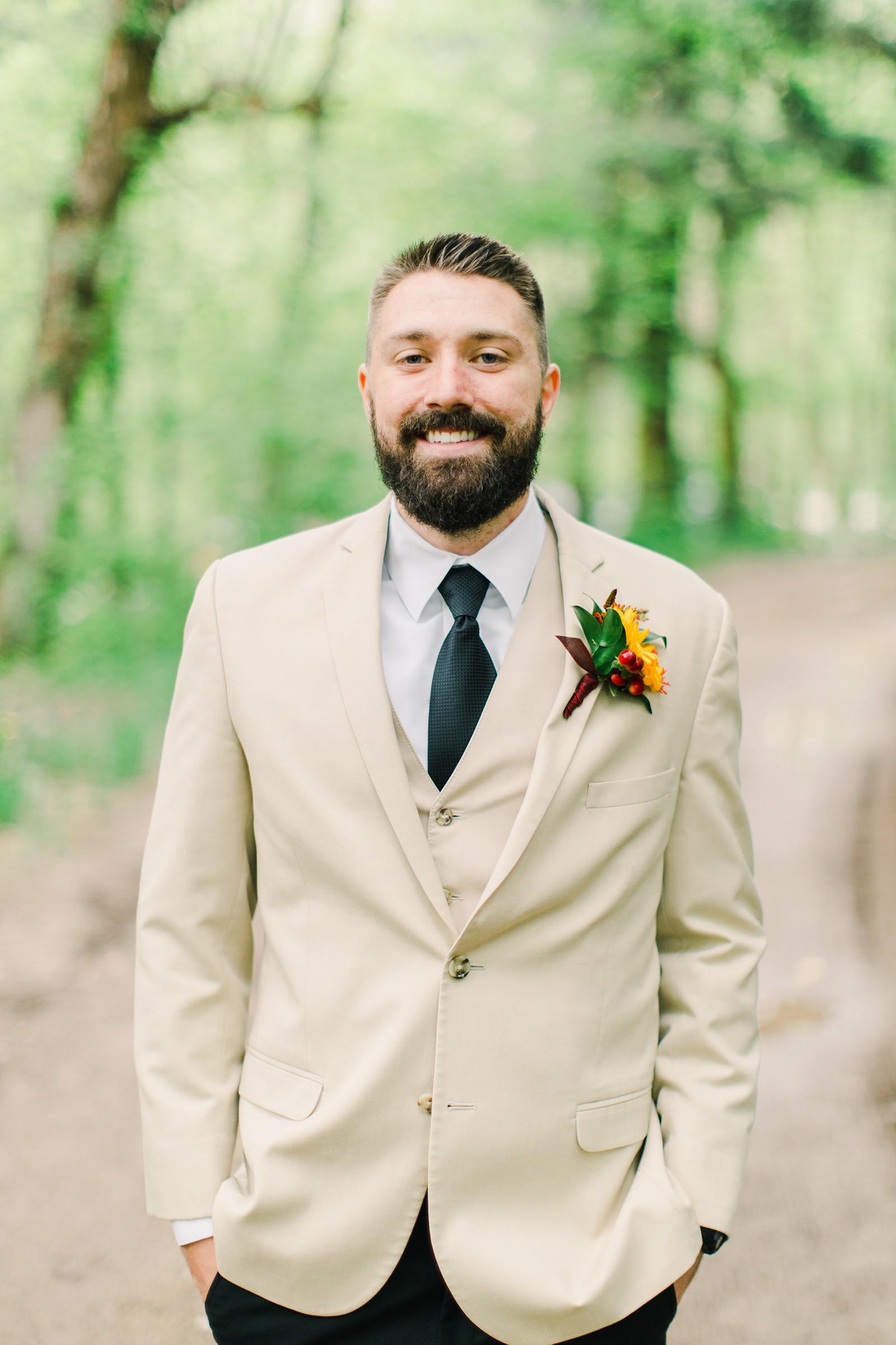 Millcreek Inn Summer Wedding, Utah wedding photography Millcreek Canyon, Salt Lake City, groom in suit with tan jacket and black pants, navy tie,