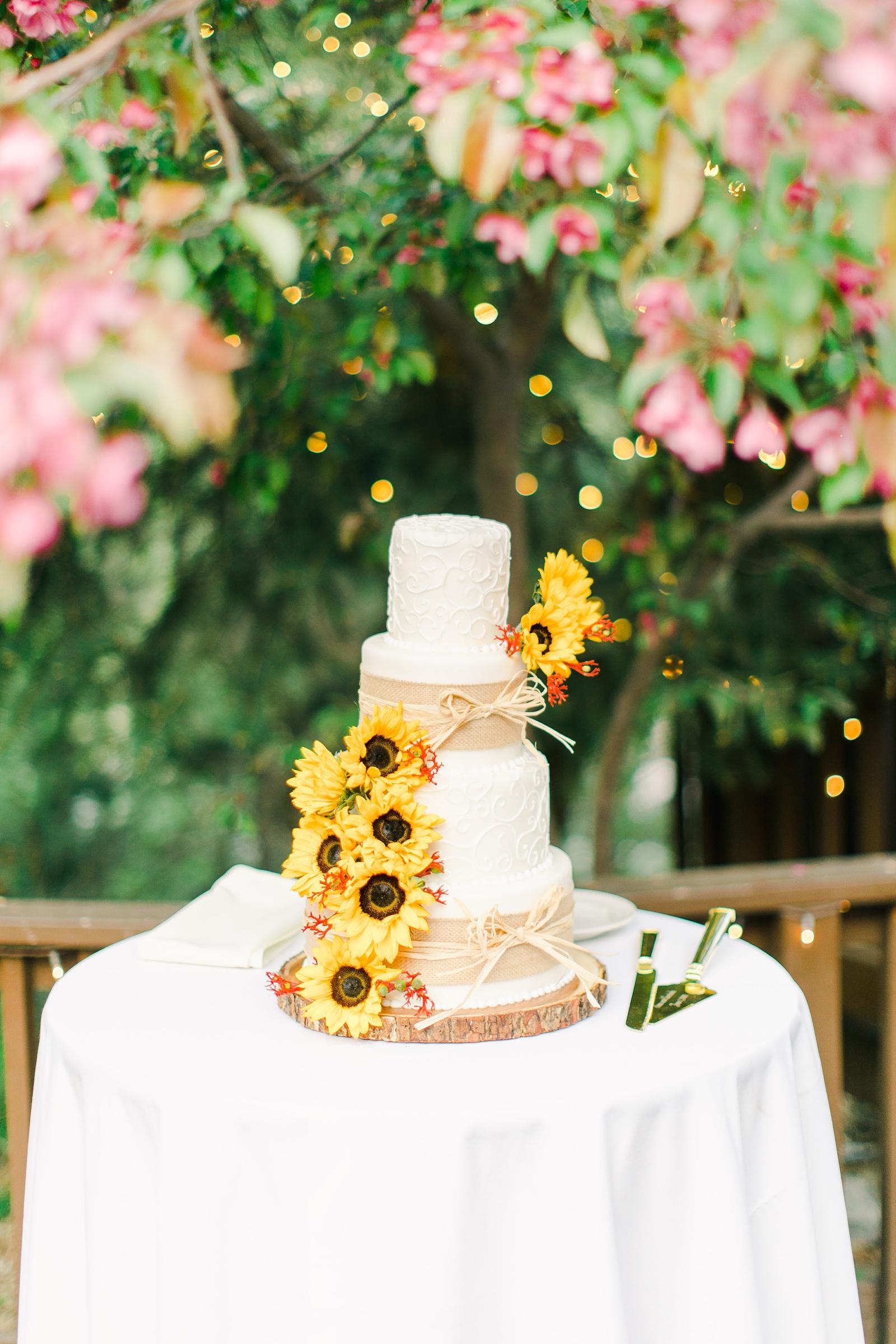 Millcreek Inn Summer Wedding, Utah wedding photography Millcreek Canyon, Salt Lake City, three tier white buttercream wedding cake with sunflowers