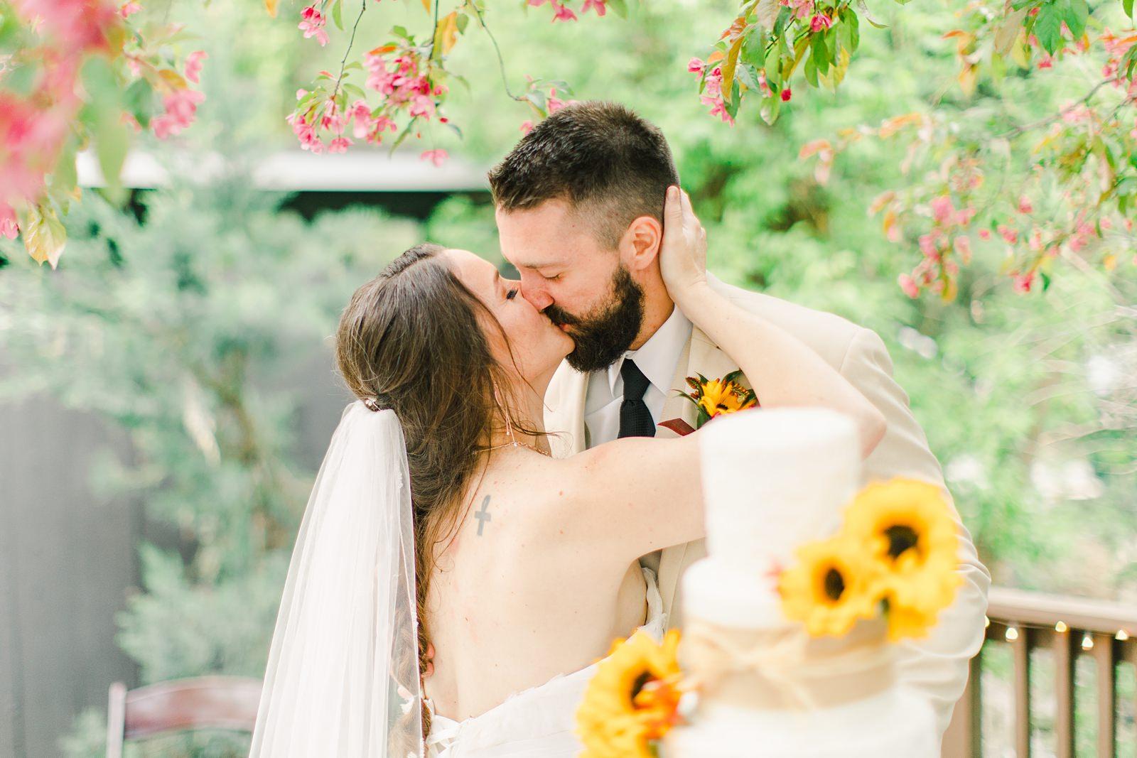 Millcreek Inn Summer Wedding, Utah wedding photography Millcreek Canyon, Salt Lake City, bride and groom kiss