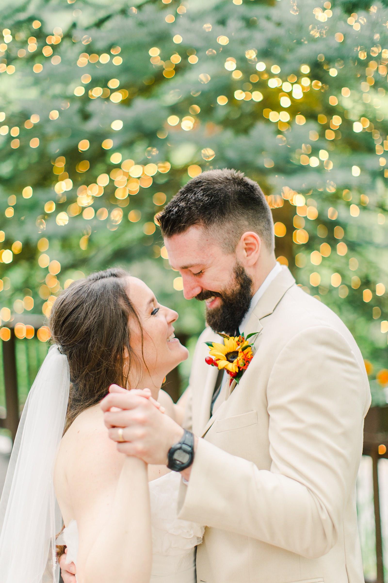 Millcreek Inn Summer Wedding, Utah wedding photography Millcreek Canyon, Salt Lake City, bride and groom first dance twinkle garden lights
