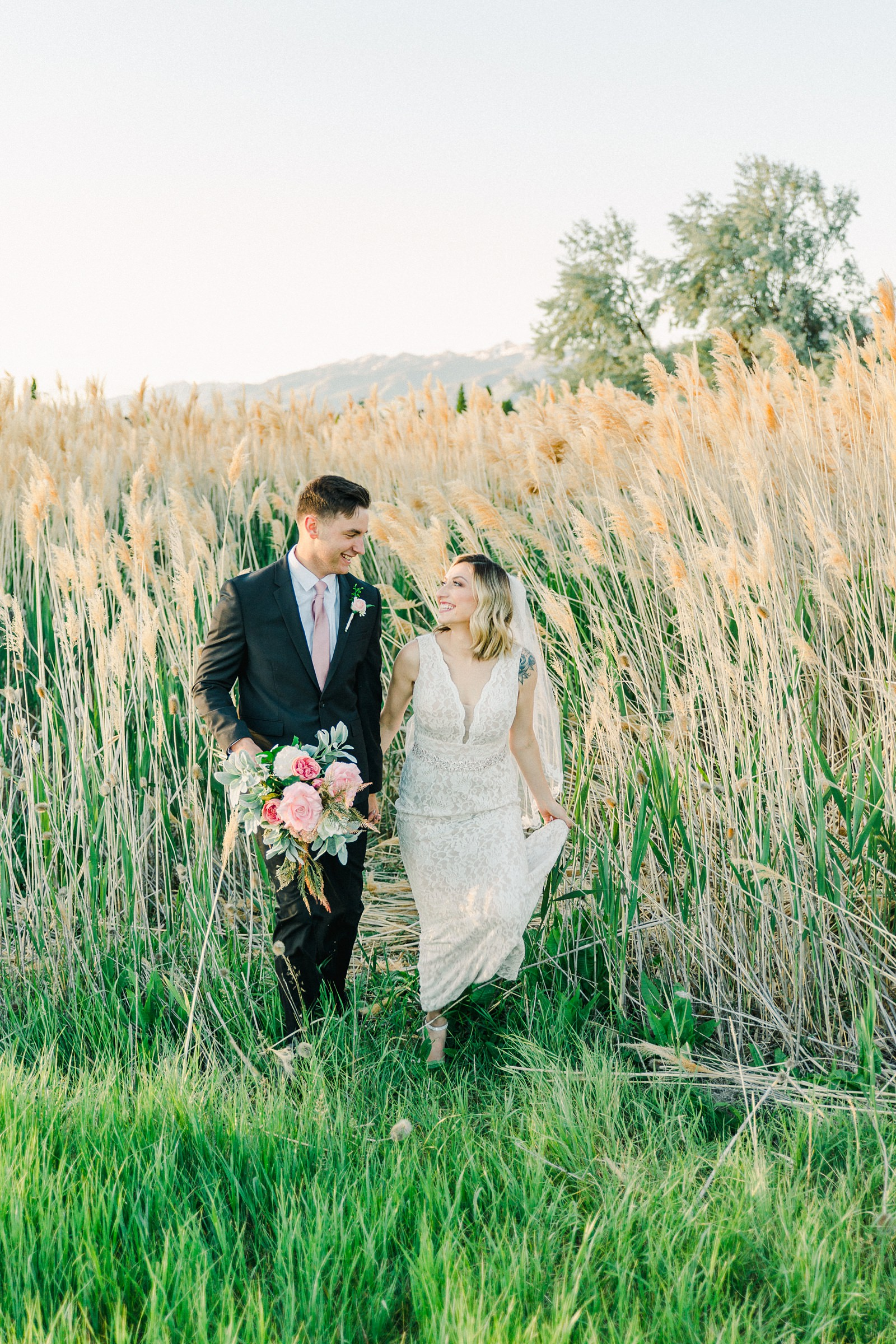Salt Lake City Utah Bridal Wedding Photography, Tunnel Springs Park, bride and groom in long grasses cattails