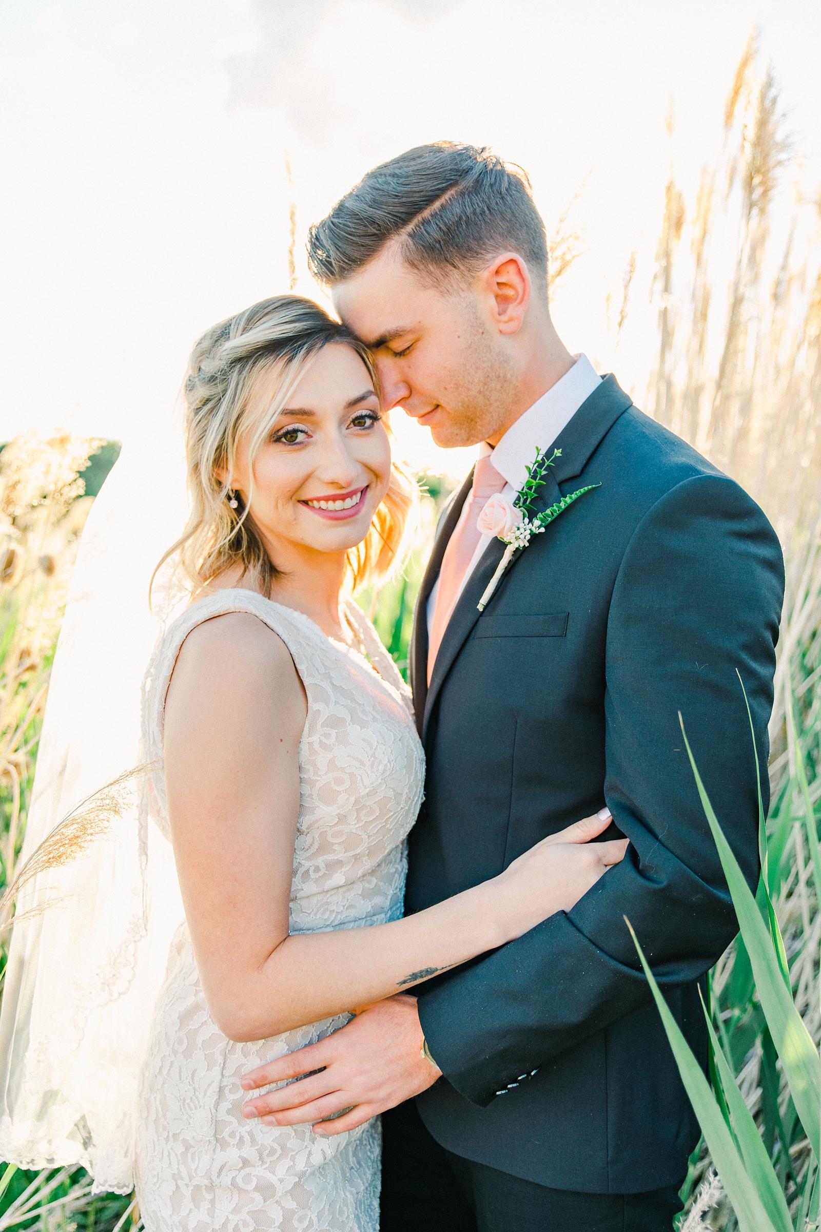 Salt Lake City Utah Bridal Wedding Photography, Tunnel Springs Park, bride and groom in long grasses cattails golden sunset light