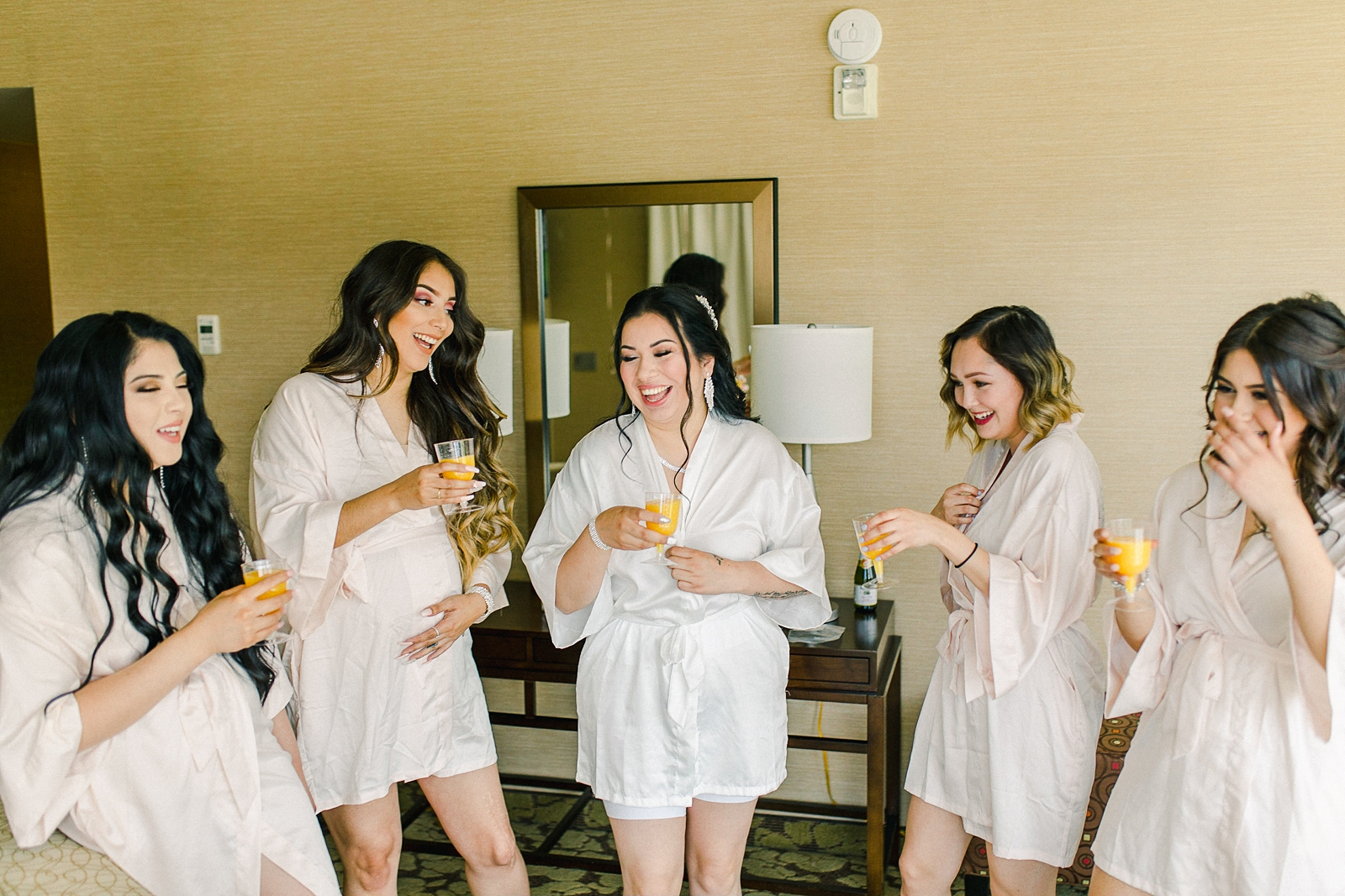 Cache Valley Logan Traditional Catholic Wedding Ceremony in a cathedral, Utah wedding photography, bride getting ready photos, bride and bridesmaids in robes