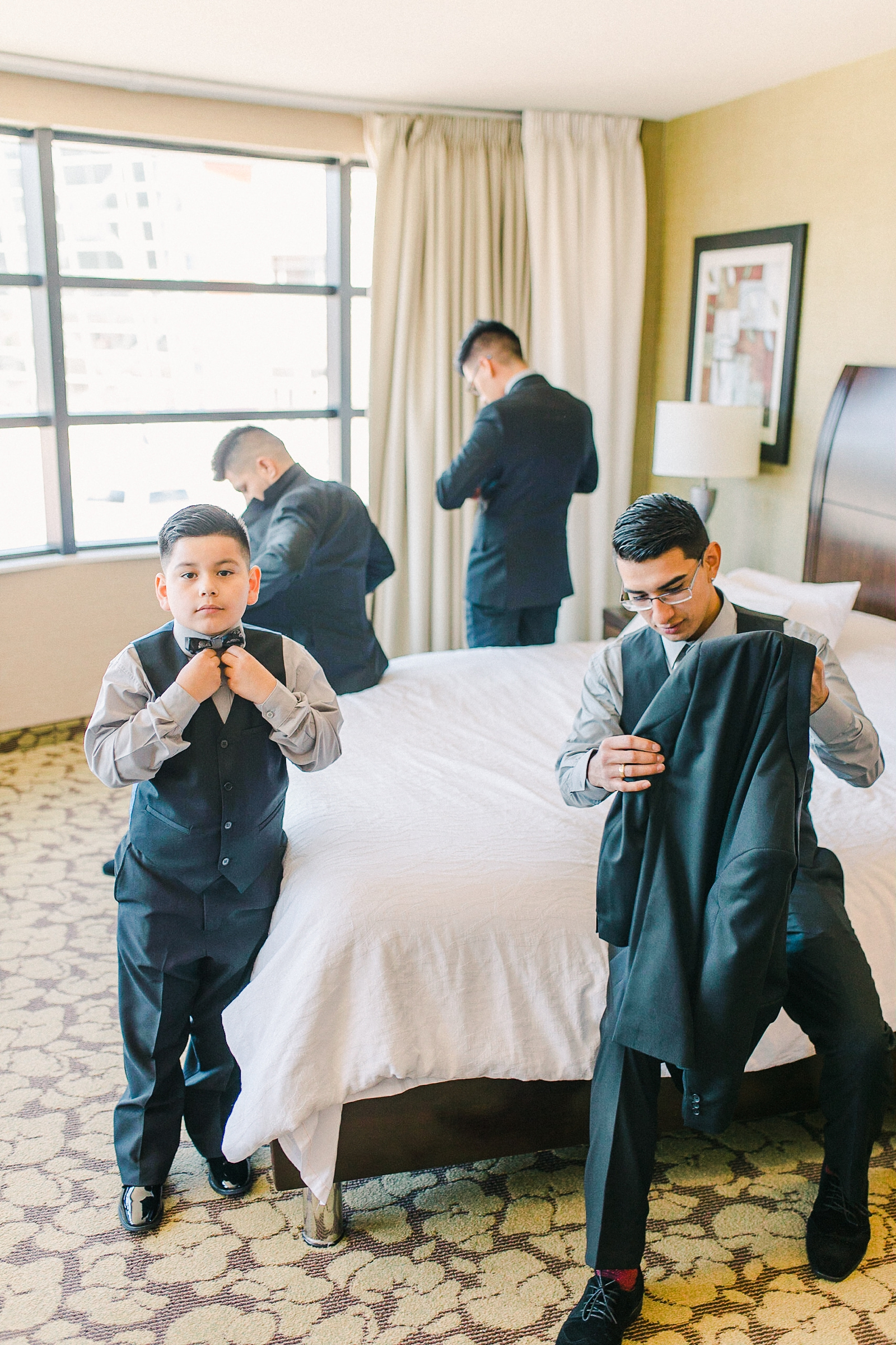 Cache Valley Logan Traditional Catholic Wedding Ceremony in a cathedral, Utah wedding photography, groom and groomsmen getting ready hotel photos